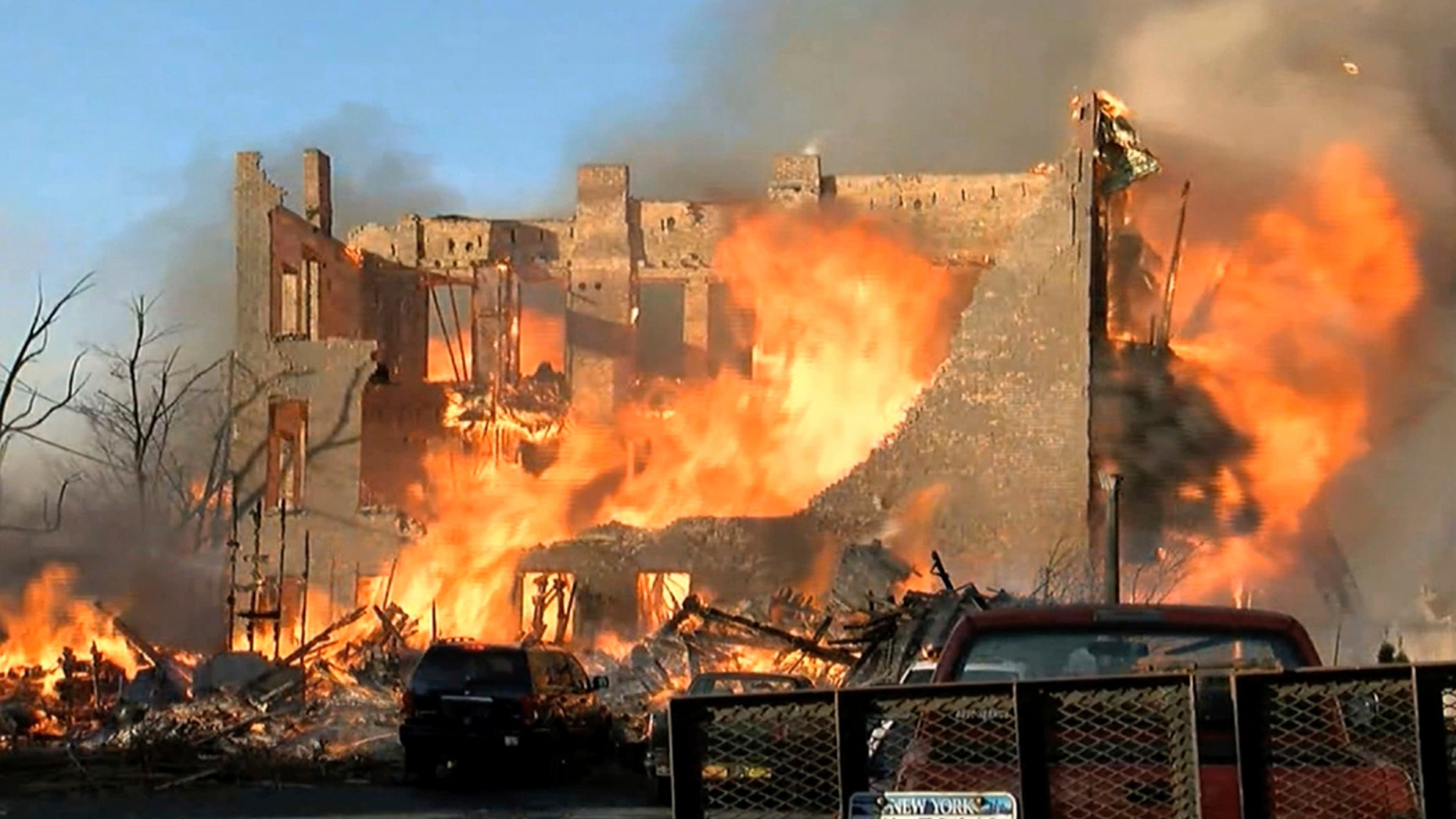 """In this image taken from video provided by WRGB-TV, Albany, a fire burns in buildings, Thursday, Nov. 30, 2017, in downtown Cohoes, N.Y. An inferno that destroyed or damaged nearly two dozen buildings in a city in upstate New York was sparked by an amateur bladesmith who apparently was trying to imitate something he saw on TV, officials said. """"It is the worst disaster the city has ever seen,"""" Mayor Shawn Morse told reporters at an evening news conference. (WRGB-TV, Albany via AP)"""