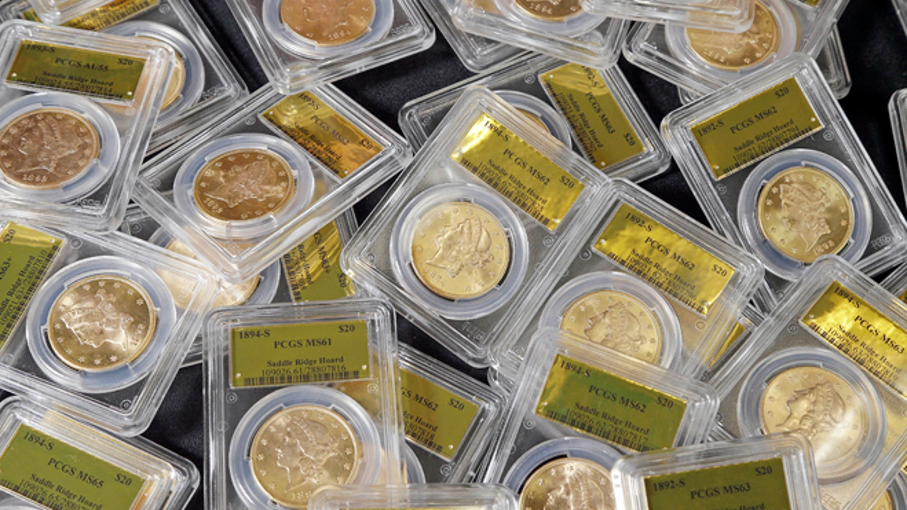 Feb. 25, 2014: This file photo shows some of the 1,427 Gold-Rush era U.S. gold coins displayed at Professional Coin Grading Service in Santa Ana, Calif.