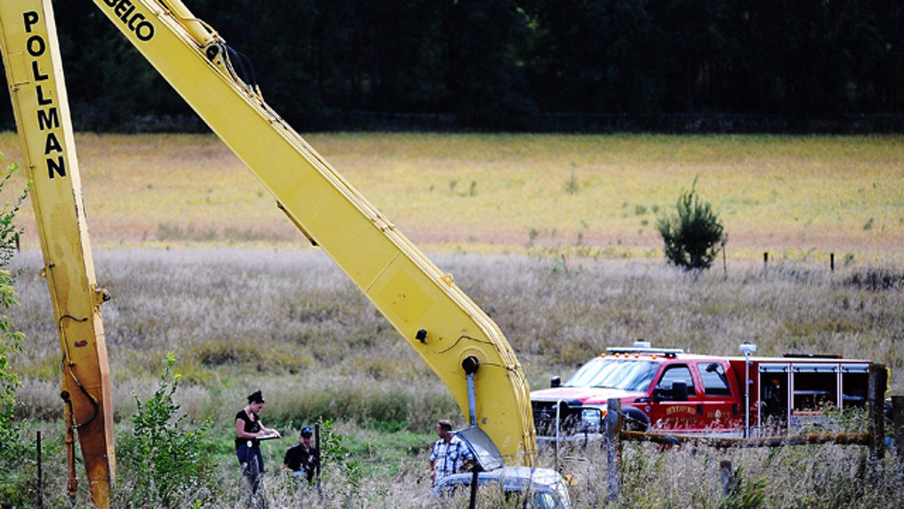 Sept. 23, 2013: Crews work to excavate a vehicle from an embankment near Beresford, S.D.