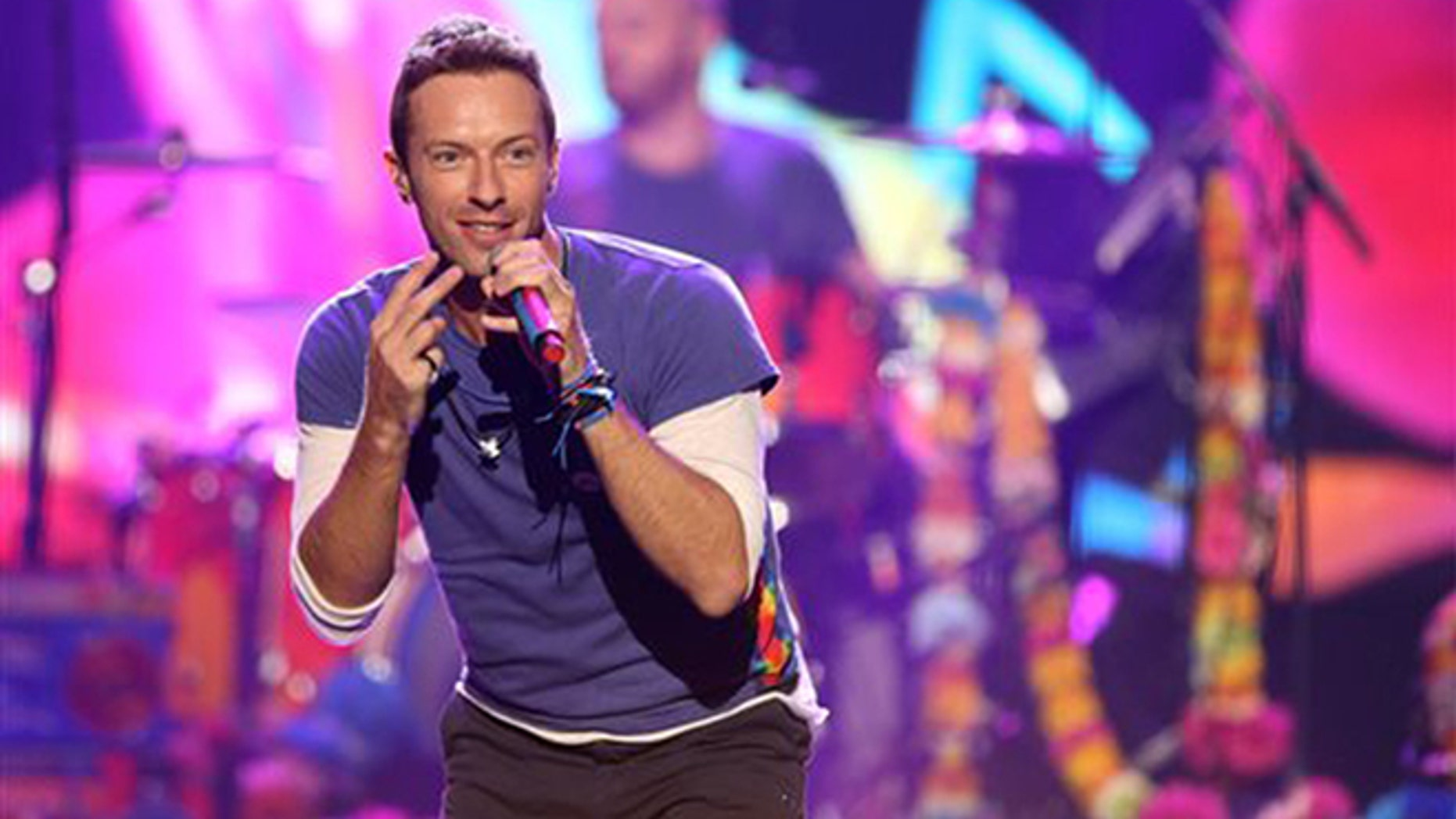 FILE - In this Sunday, Nov. 22, 2015 file photo, Chris Martin of Coldplay performs at the American Music Awards at the Microsoft Theater, in Los Angeles. (Photo by Matt Sayles/Invision/AP, File)