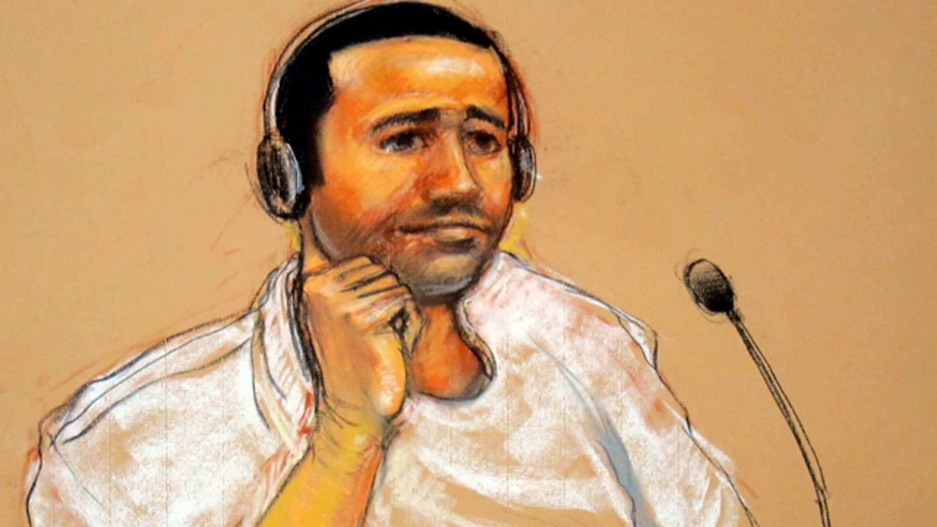 Nov. 9: In this sketch by courtroom artist Janet Hamlin, reviewed by the U.S. military, Abd al-Rahim al-Nashiri is seen during his military commissions arraignment at the Guantanamo Bay.
