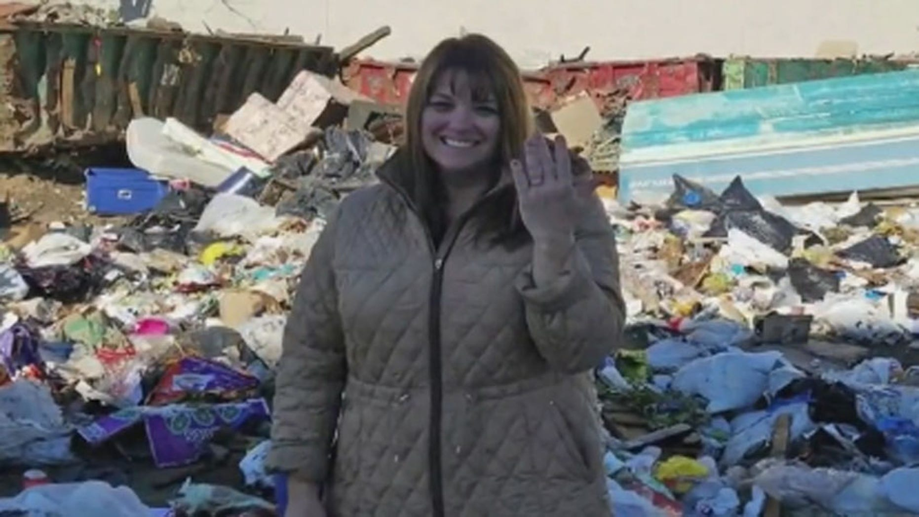 Colleen Dyckman, of Long Island, with the rings she accidentally tossed in the trash. (CBS New York)