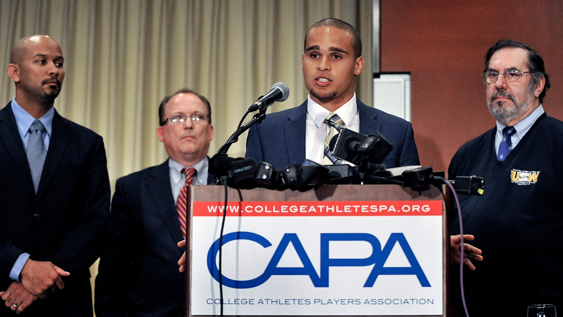 Jan. 28, 2014: Northwestern quarterback Kain Colter second from right, speaks while College Athletes Players Association president Ramogi Huma left, United Steel Workers National Political Director Tim Waters second from left, and United Steel Workers president Leo Gerard right, look on during a news conference in Chicago.