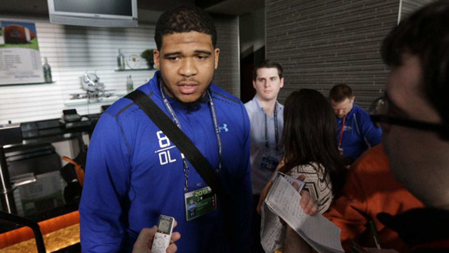 La'el Collins is considered one of the top prospects in Thursday's NFL draft. Baton Rouge police reportedly want to question him after a pregnant woman's murder. He is not a suspect.