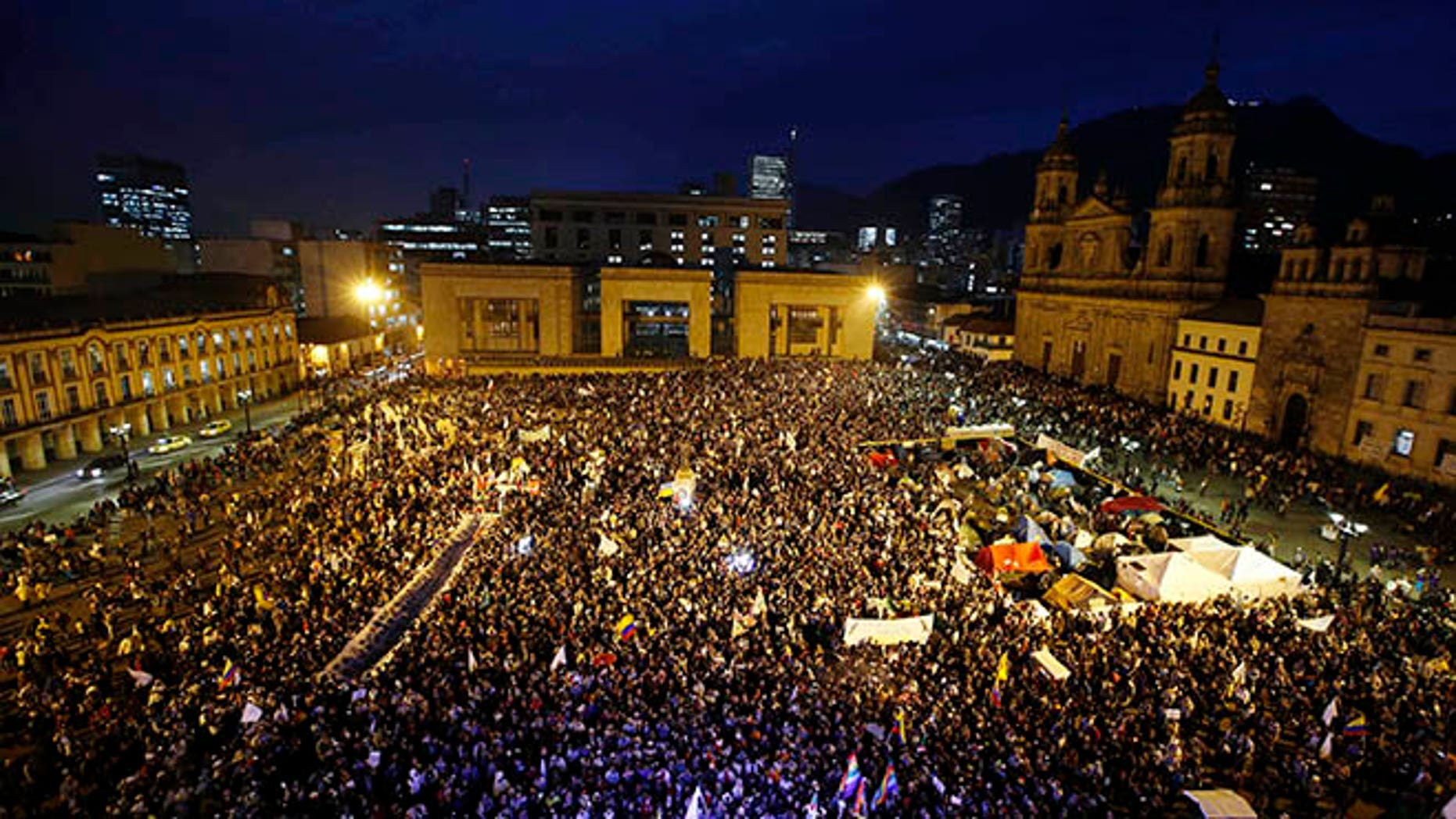 People gather at Bolívar square during a peace march in Bogotá, Colombia, Wednesday, Oct. 12, 2016.