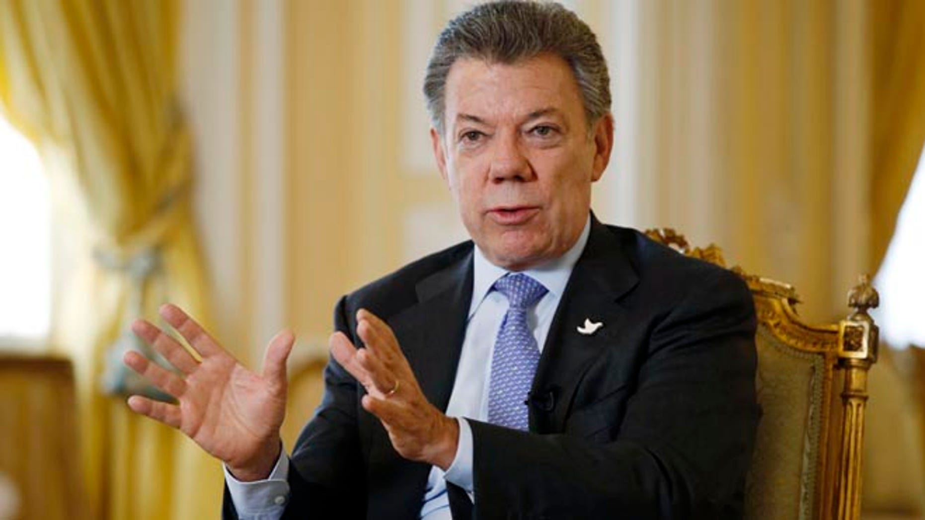 Colombia's President Juan Manuel Santos answers a question during an interview at the Presidential Palace in Bogota, Colombia, Thursday, Jan. 28, 2016.  President Santos is hoping the U.S. will suspend drug warrants against guerrilla commanders and remove the Revolutionary Armed Forces of Colombia from a list of terrorist groups to help cinch a peace deal with Latin Americaâs insurgency. (AP Photo/Fernando Vergara)