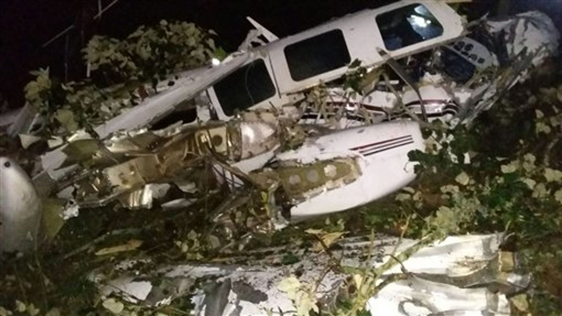 This photo released by the San Predro de los Milagros Fire Department shows the wreckage of a small plane assigned to the crew of a film starring Tom Cruise, that crashed, in a rural place of San Pedro de los Milagros, Colombia, Friday, Sept. 11, 2015. The country's civilian aviation authority said the twin-engine Aerostar crashed Friday after taking off from a small colonial town near Medellin, killing two people, including a Los Angeles-based film pilot, and seriously injuring a third. (San Pedro de los Milagros Fire Department via AP)