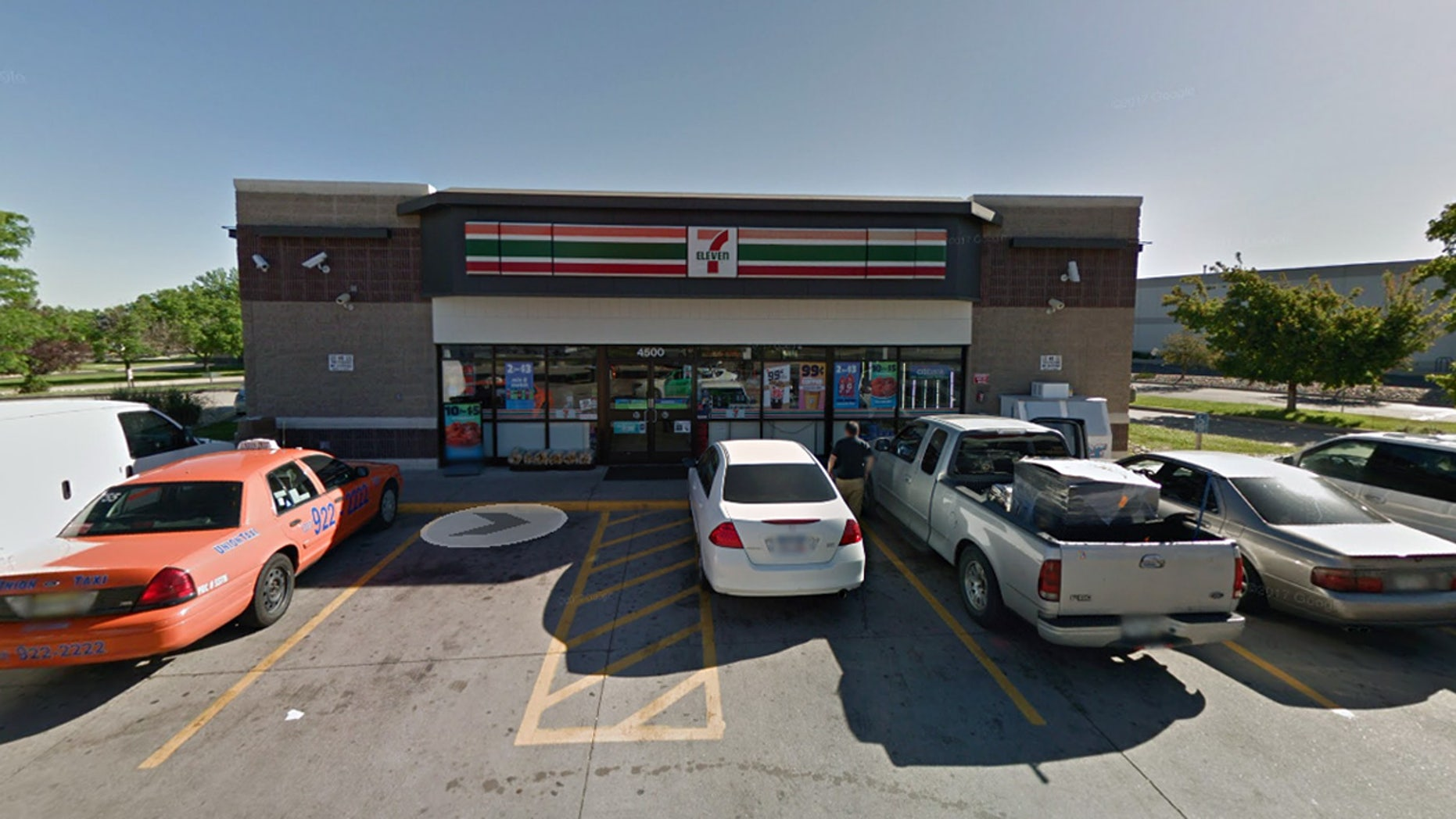 The corrections workers were discovered kissing each other in the parking lot of this 7-Eleven in Denver.