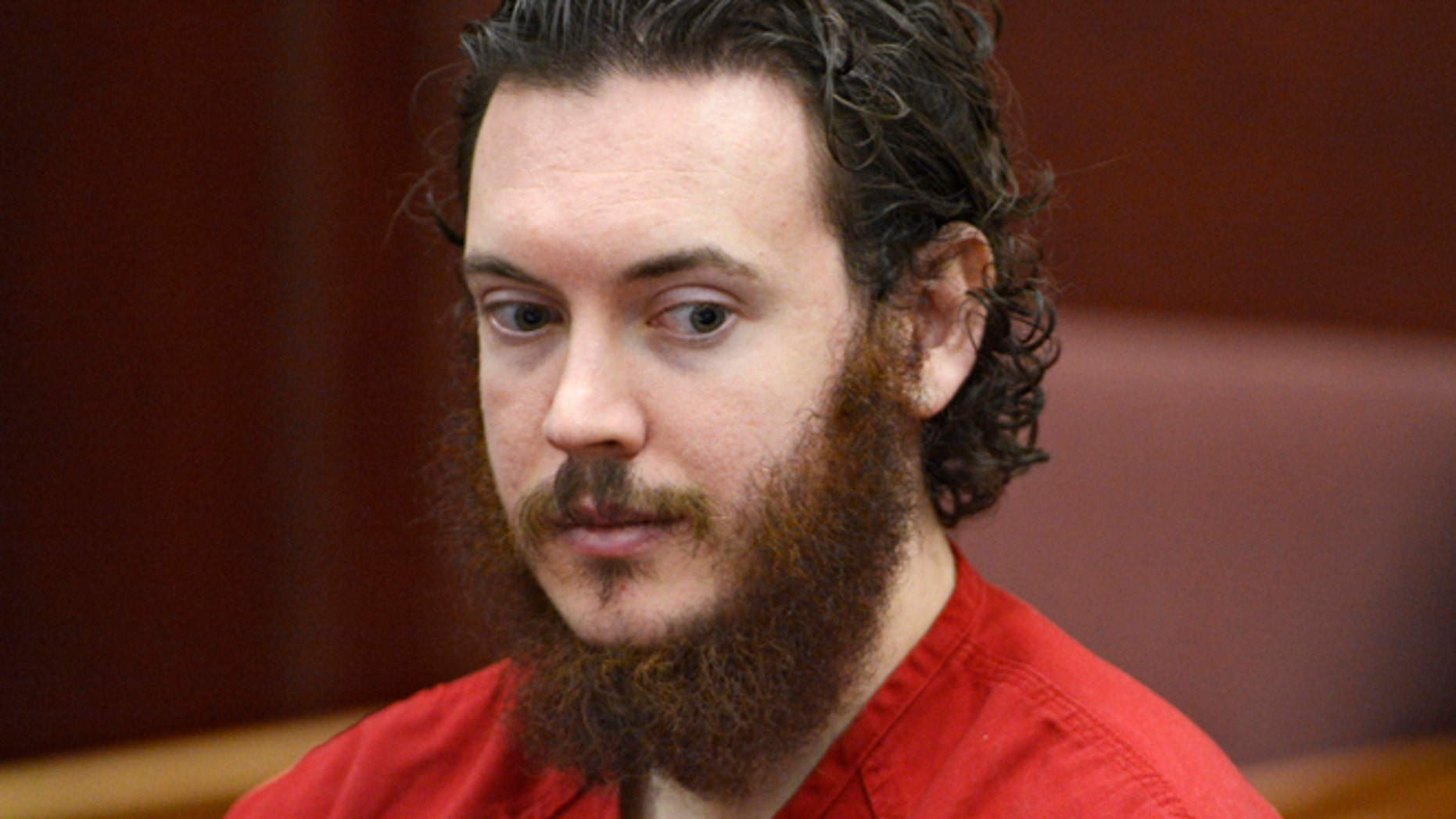 June 4, 2013: File photo, Aurora theater shooting suspect James Holmes is seated in court in Centennial, Colo.
