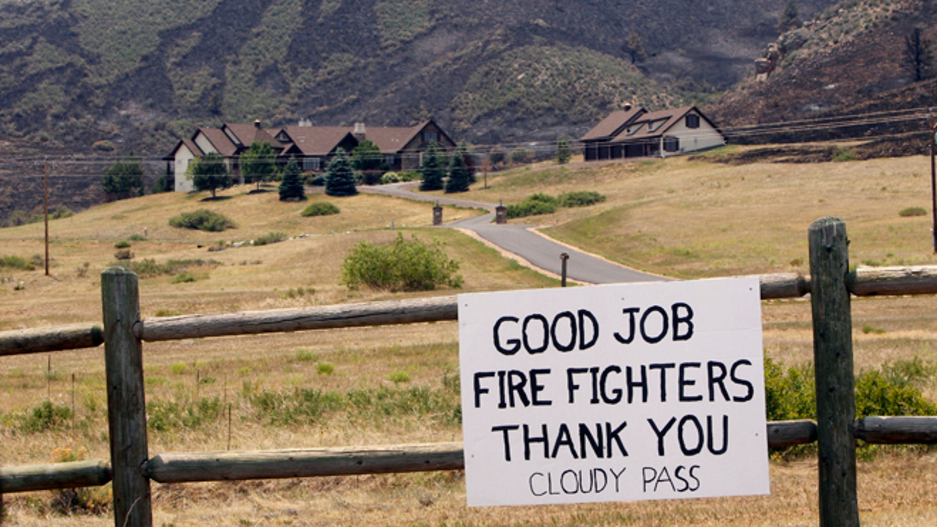 June 18: A sign thanking firefighters near Bellvue,  Colo.