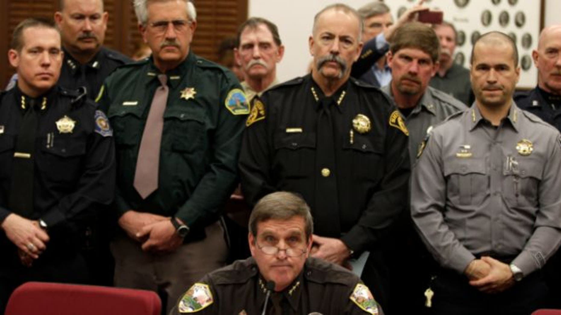 March 4, 2013: Weld County Sheriff John Cooke, center, backed by a group of fellow sheriffs, testifies against proposed gun control legislation in the Colorado Legislature, at the State Capitol, in Denver.