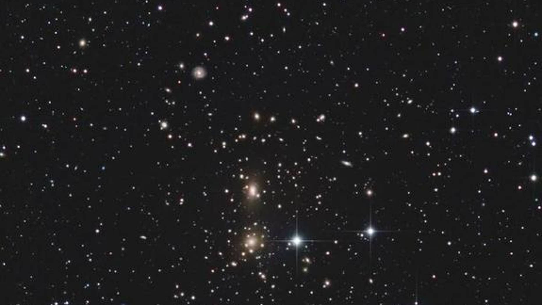 The Coma galaxy cluster is a collection of more than 650 galaxies about 300 million light-years from Earth in the constellation Coma Berenices. Also known as Abell 1656, the galaxy cluster is one of the densest ones known.