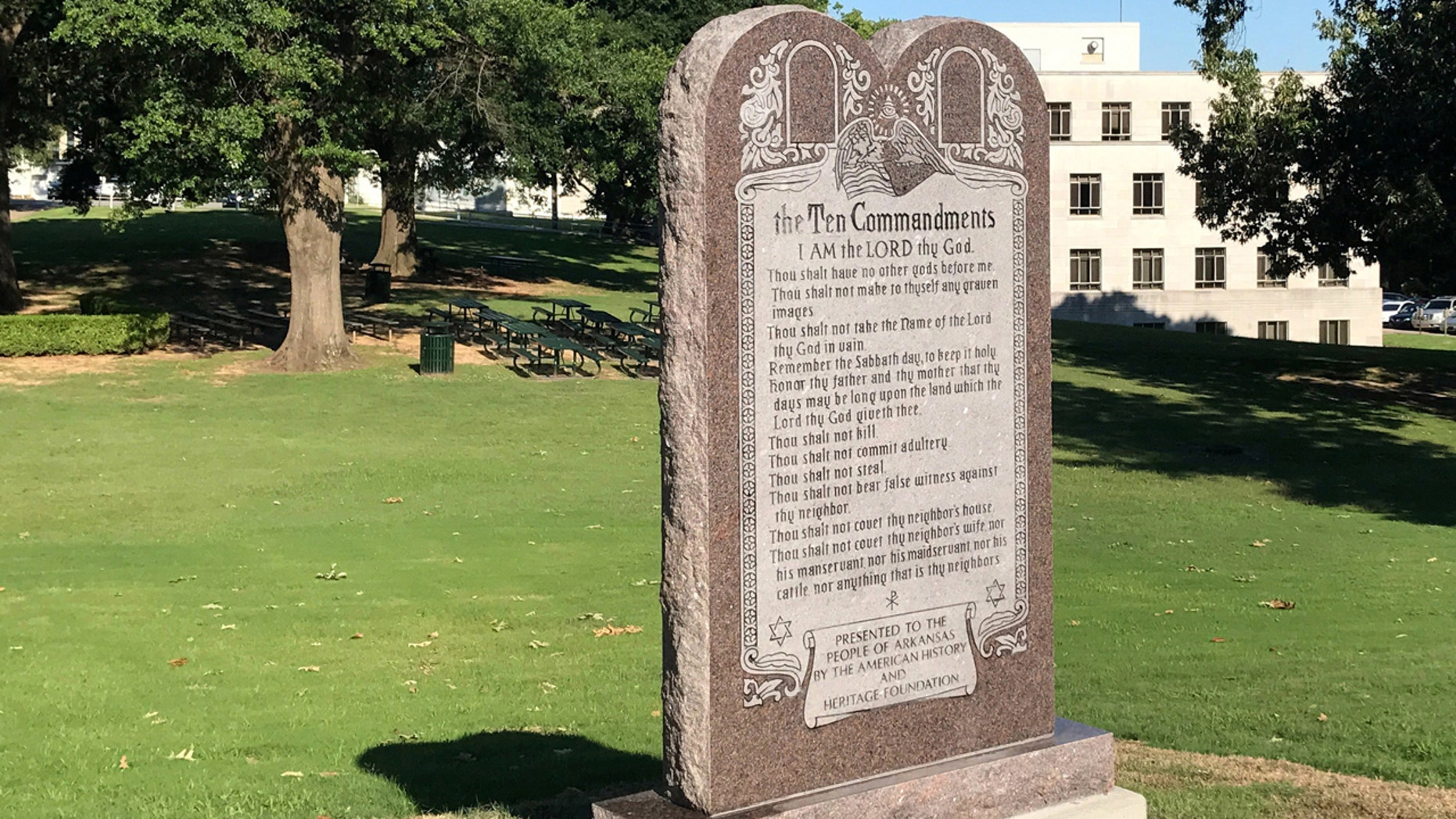 A 6-foot-tall privately funded Ten Commandments monument is seen on the Arkansas Capitol grounds in Little Rock on Tuesday, June 27, 2017, after it was installed by workers two years after lawmakers approved a measure allowing the statue on state property.