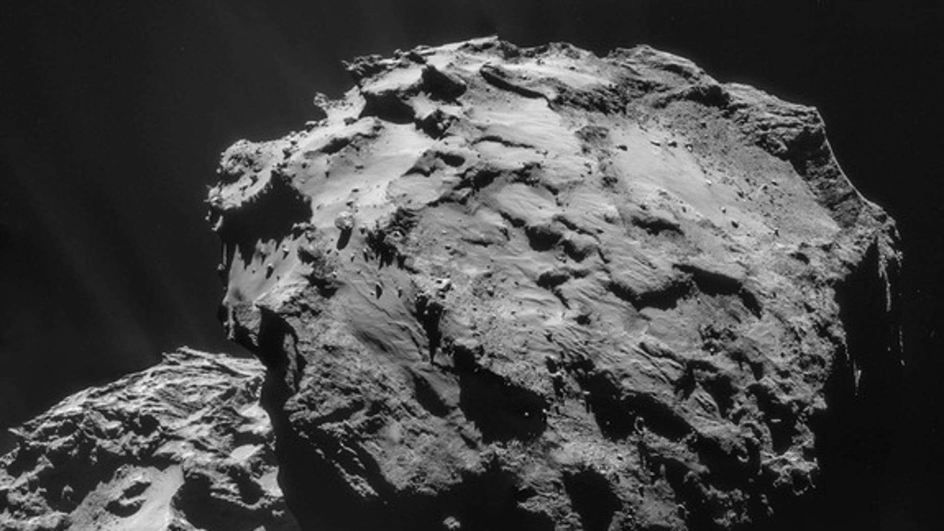 Rosetta's navigation camera obtained the four images in this mosaic on Dec. 7, 2014, from a distance of 12.2 miles (19.7 km) from the center of Comet 67P/Churyumov-Gerasimenko.