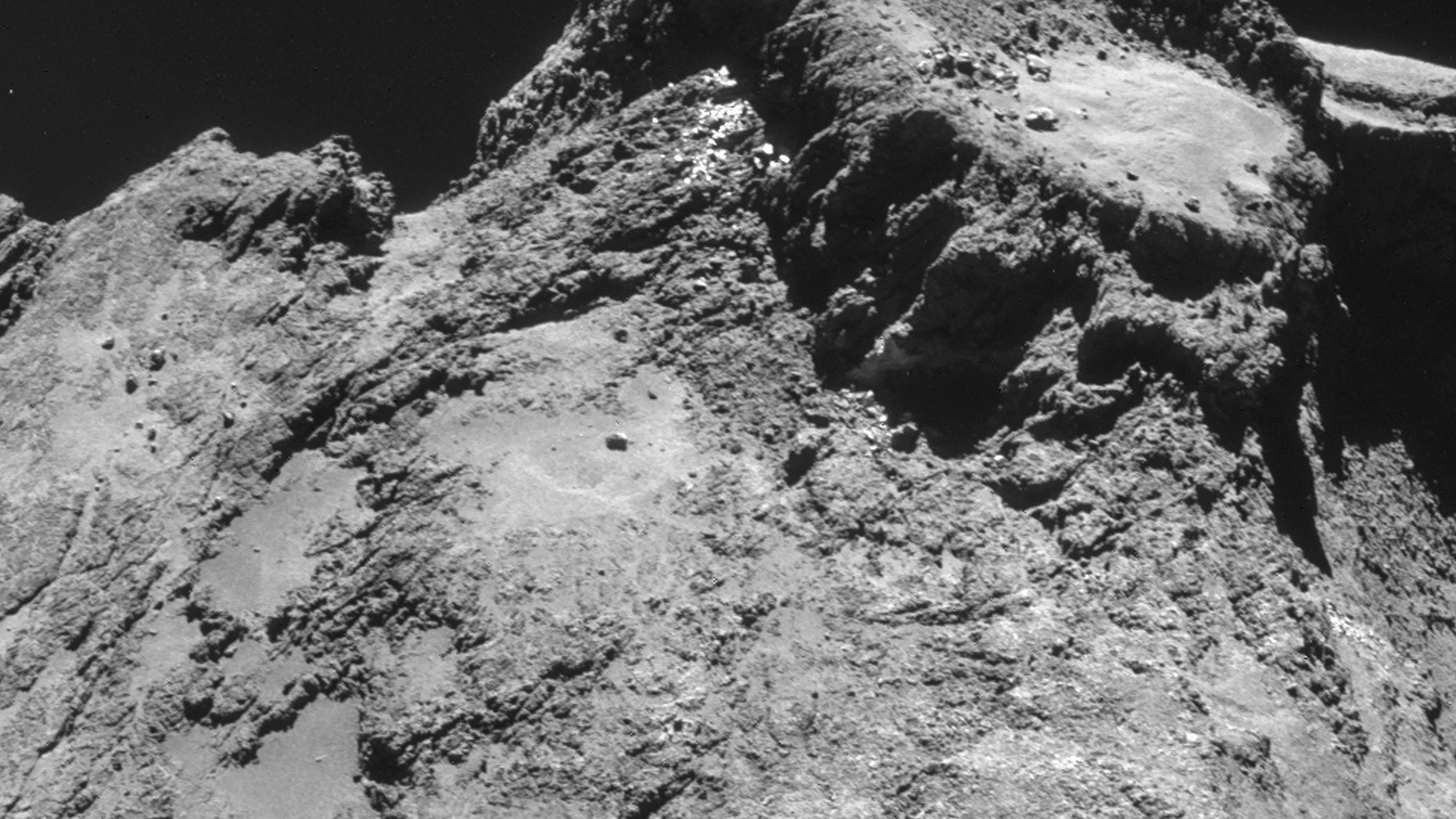 Oct. 24, 2014: The picture taken with the navigation camera on Rosetta and released by the European Space Agency ESA shows a raised plateau on the larger lobe of Comet 67P/Churyumov–Gerasimenko.