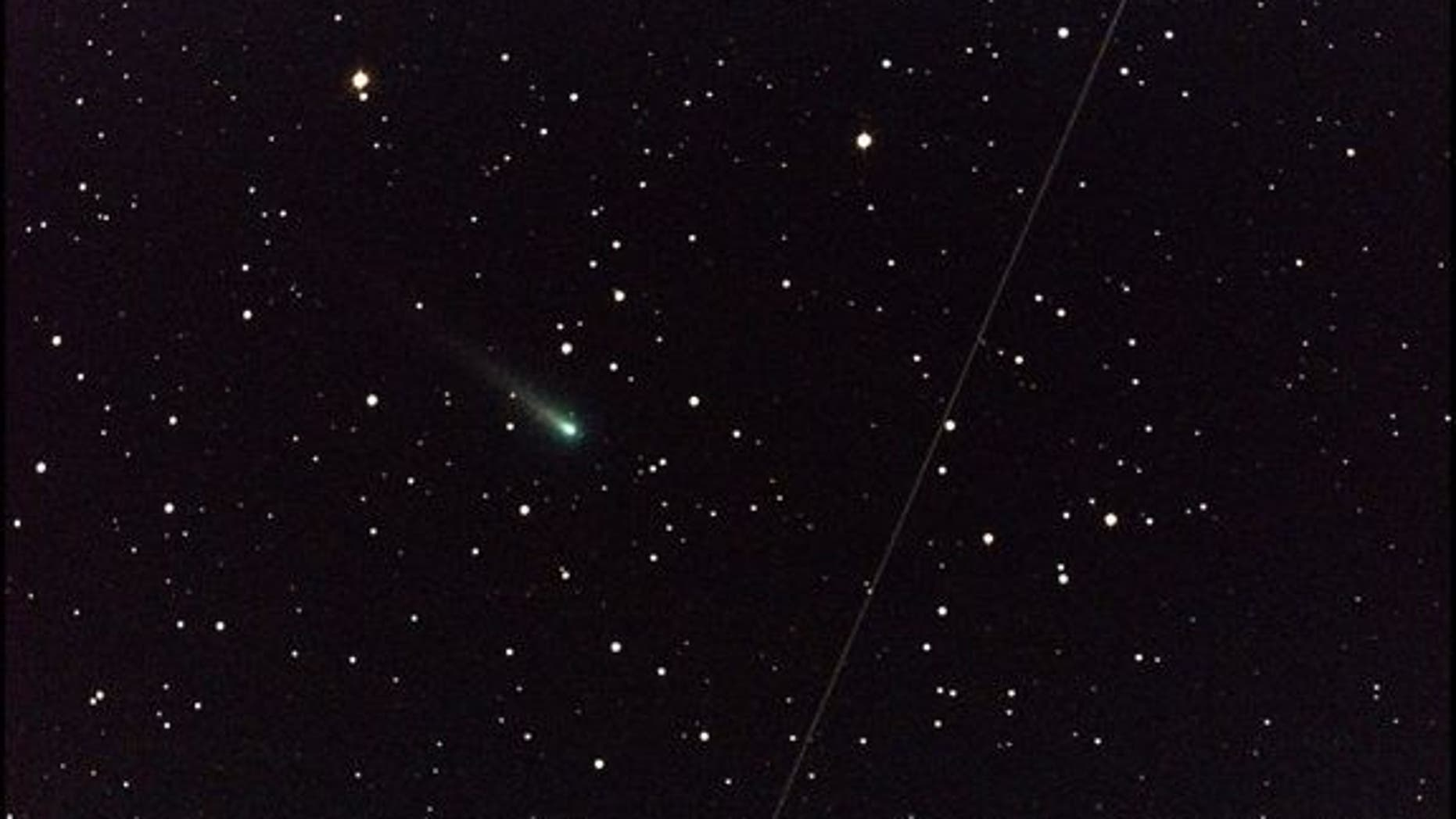"In the early morning of Oct. 25, 2013, NASA's Marshall Space Flight Center in Huntsville, Ala., used a 14"" telescope to capture this image of Comet ISON (the greenish object just left of center) cruising through the constellation of Leo the Lio"