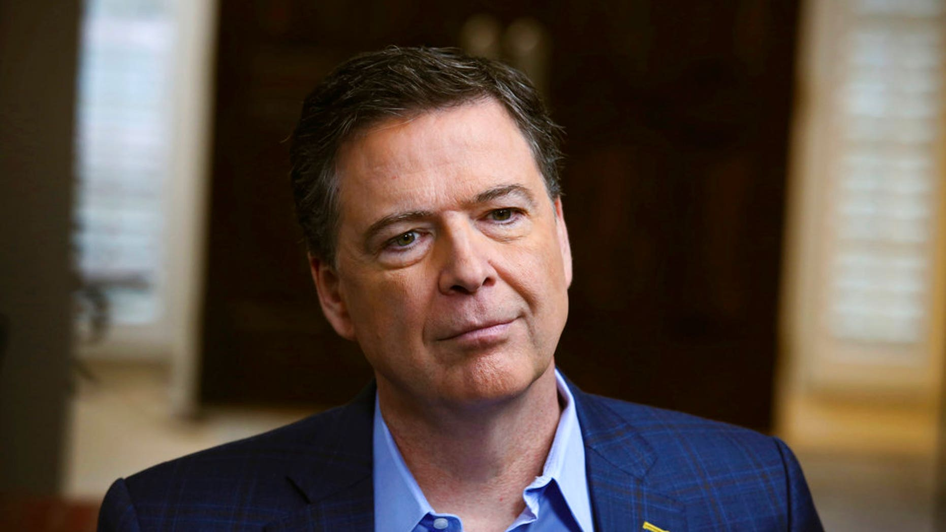 "In this image released by ABC News, former FBI director James Comey appears at an interview with George Stephanopoulos that will air during a primetime ""20/20"" special on Sunday, April 15, 2018 on the ABC Television Network. Comey's book, ""A Higher Loyalty: Truth, Lies, and Leadership,"" will be released on Tuesday. (Ralph Alswang/ABC via AP)"