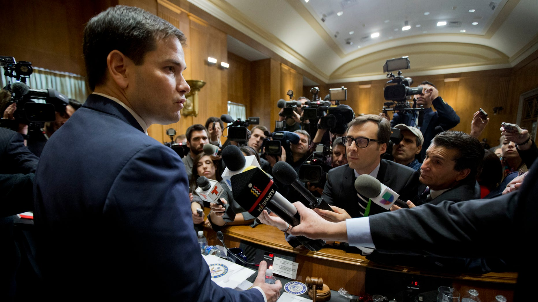 Sen. Marco Rubio speaks to reporters following a hearing on Cuba on Capitol Hill Tuesday, Feb. 3, 2015.