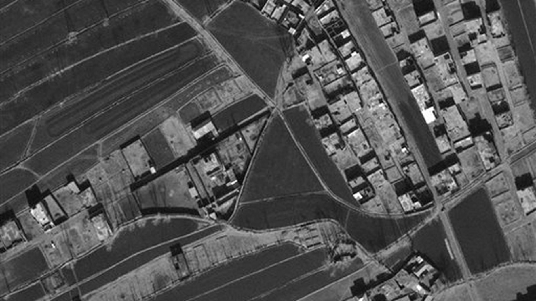 This Jan. 15, 2011 satellite image provided by DigitalGlobe shows the compound, center left, in Abbottabad, Pakistan, where Usama bin Laden lived.