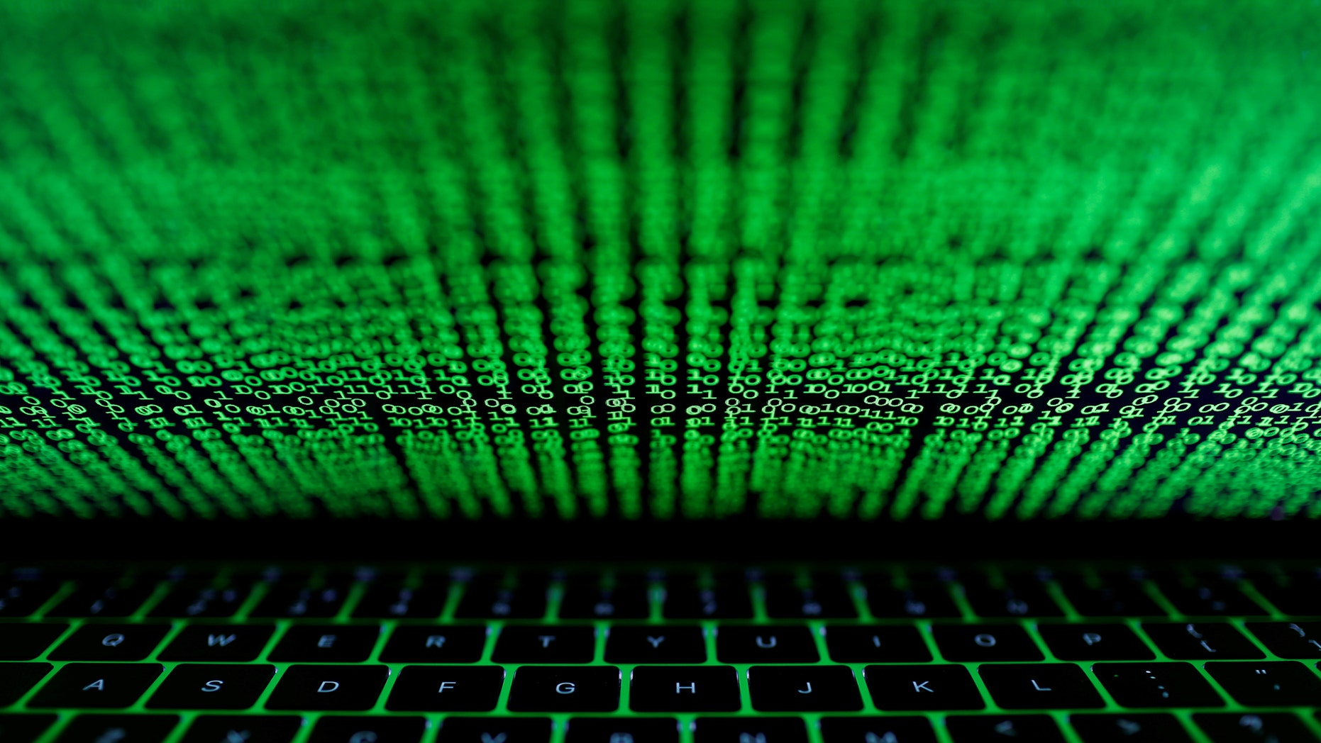 A computer keyboard lit by a displayed cyber code is seen in this illustration picture taken on March 1, 2017. (REUTERS/Kacper Pempel/Illustration)