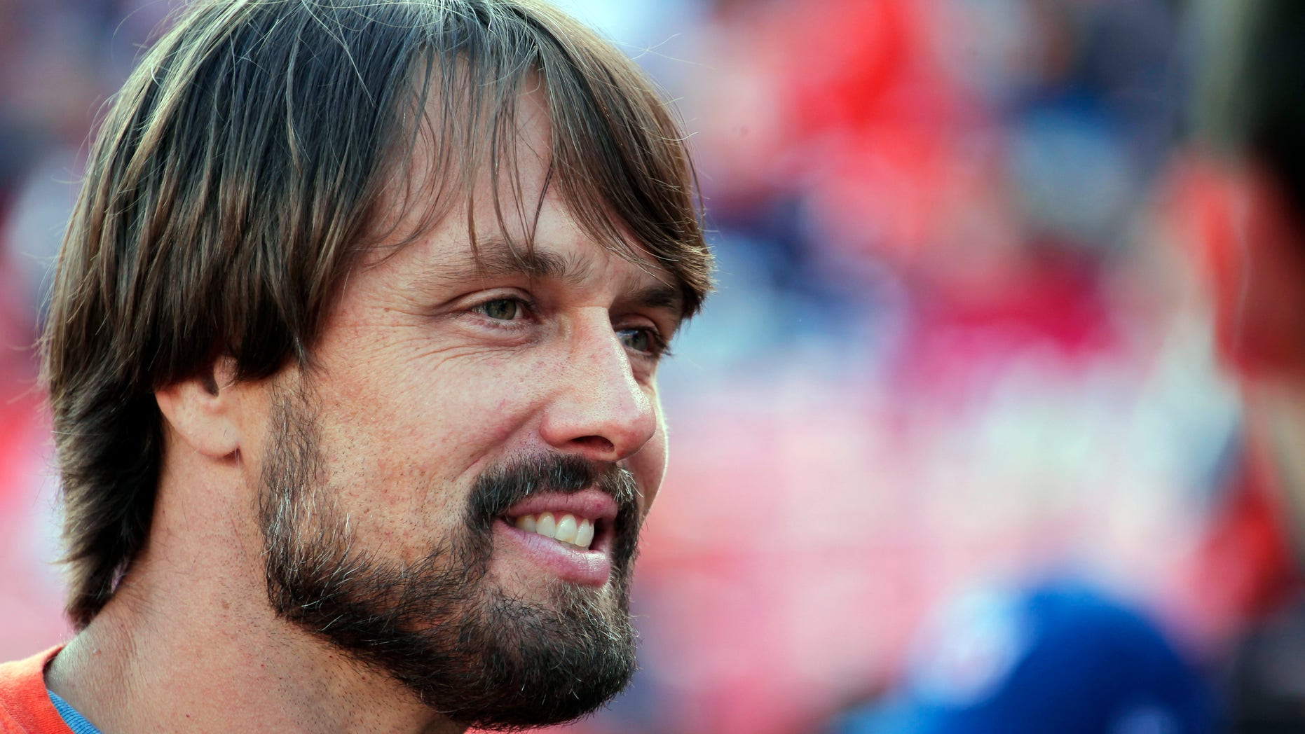 "FILE - In this Nov. 15, 2015, file photo, former Denver Broncos quarterback Jake Plummer smiles on the sidelines during an NFL football game between the Broncos and the Kansas City Chiefs in Denver. If a compound found in hemp _ and its notorious cousin, cannabis _ proves as effective in treating brain injuries as testimonials claim, it would also be welcome news for the NFL on concussions, and even better for players. Along with a handful of other retired players, Plummer felt strongly enough about the benefits to appear in a public-service campaign titled ""When the Bright Lights Fade."" (AP Photo/Jack Dempsey, File)"
