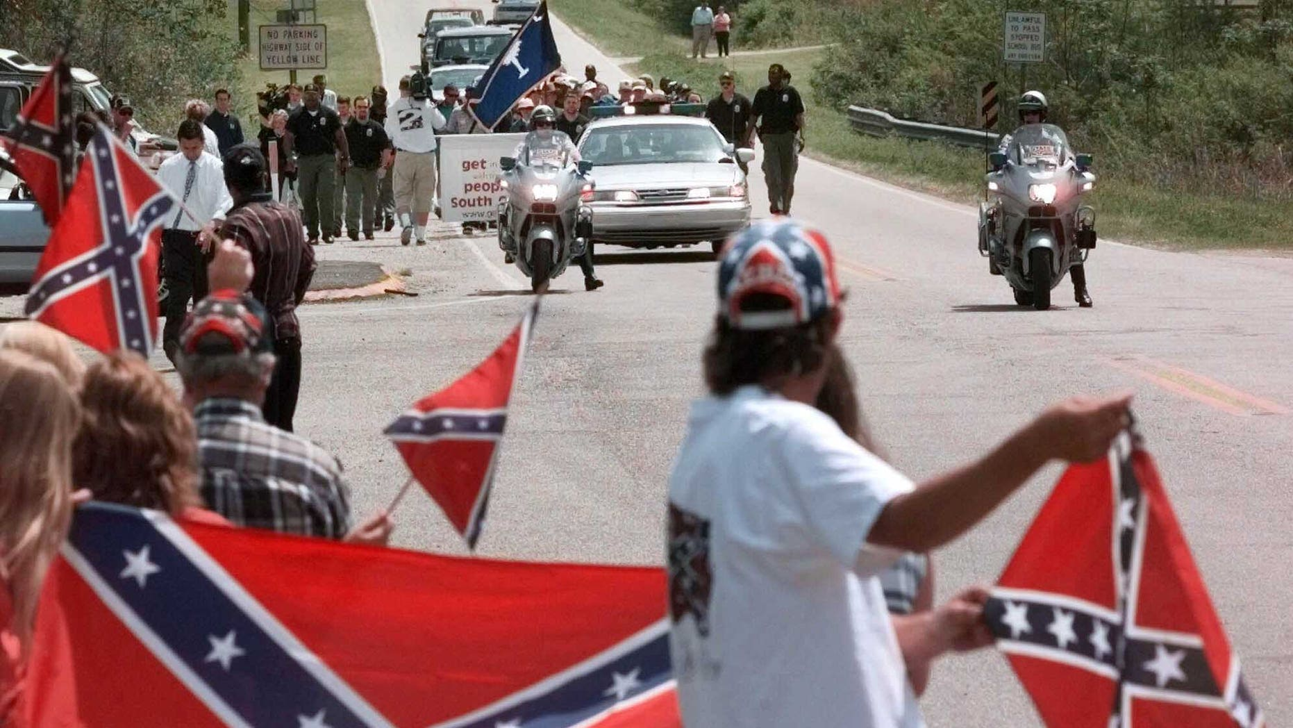 The battle flag of the Confederate army has long been controversial, but now it is being banned online and in stores. (AP Photo/Mary Ann Chastain, File)