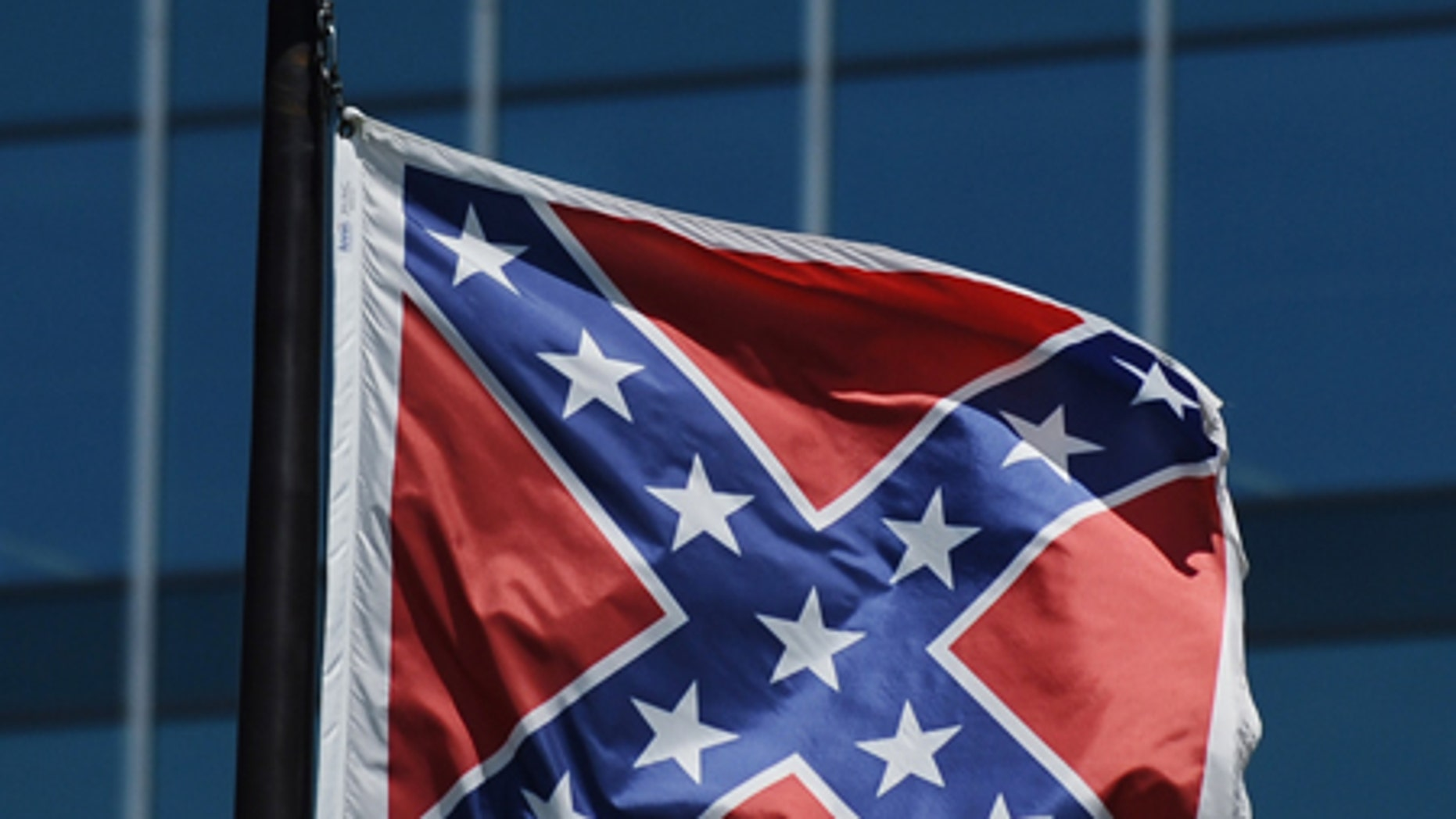 The Confederate flag flies near the South Carolina Statehouse, Friday, June 19, 2015, in Columbia, S.C. Tensions over the Confederate flag flying in the shadow of South Carolina's Capitol rose this week in the wake of the killings of nine people at a black church in Charleston, S.C. (AP Photo/Rainier Ehrhardt)