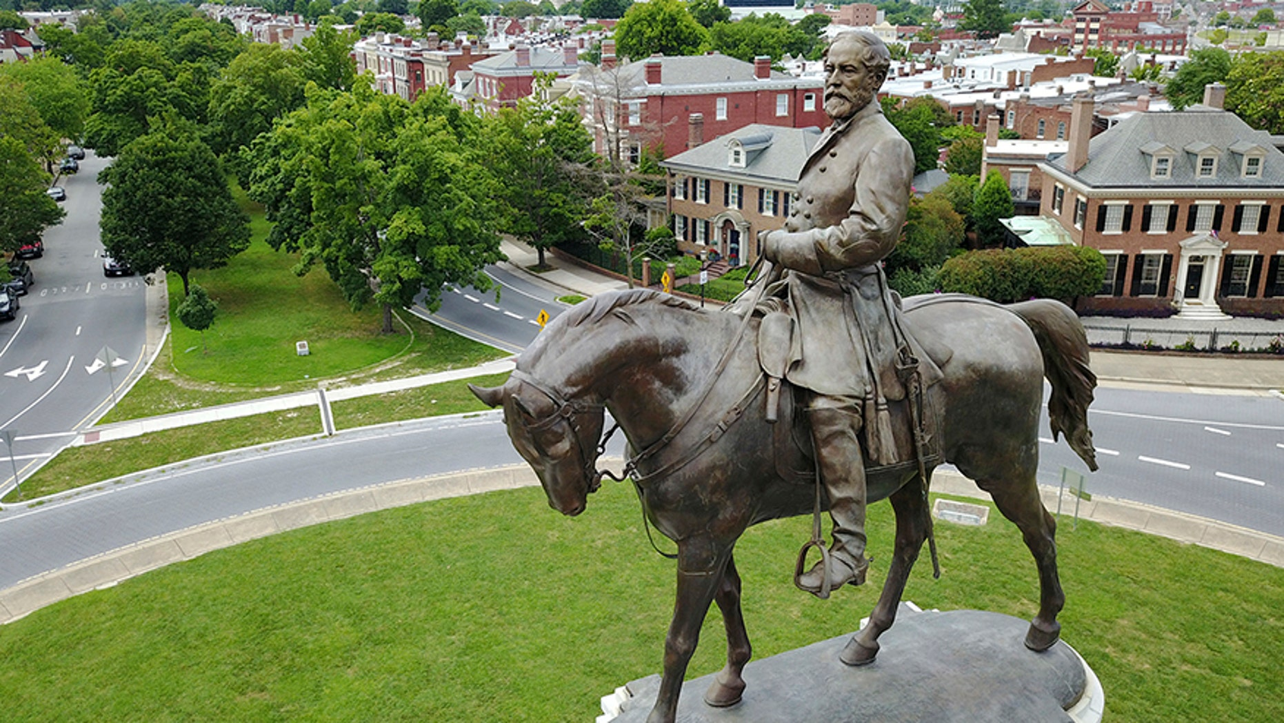The statue of Confederate Gen. Robert E. Lee that stands in the middle of a traffic circle on Monument Avenue in Richmond, Va.