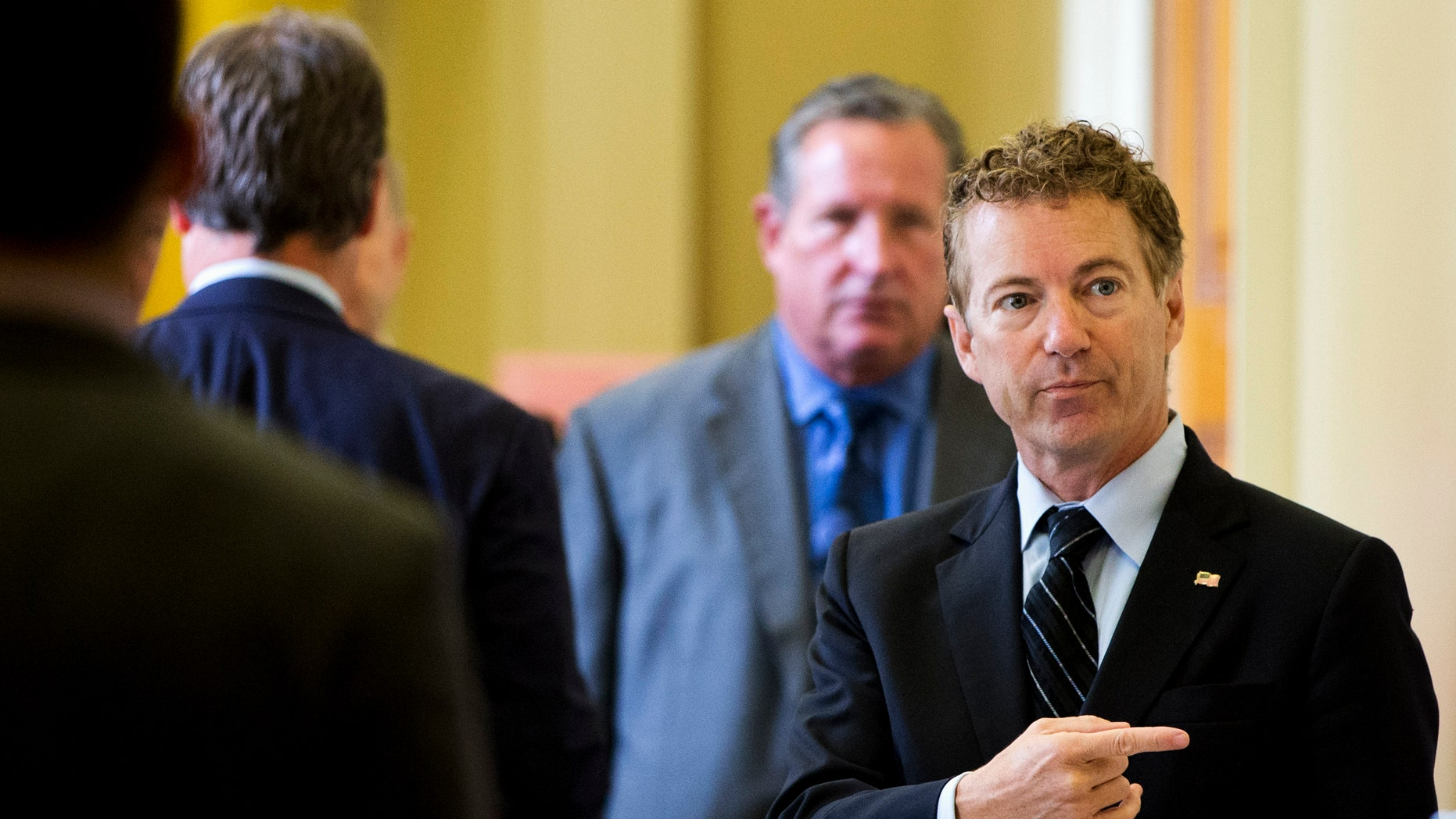 Sept. 30, 2015: Republican presidential candidate, Sen. Rand Paul, R-Ky. points while talking with visitors on Capitol Hill in Washington.