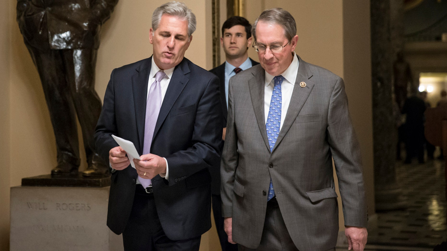House Majority Leader Kevin McCarthy, R-Calif., left, and House Judiciary Committee Chairman Bob Goodlatte, R-Va., walk to the chamber as the House votes on a rewrite of the No Child Left Behind law that rolls back the federal control in American education and returns authority to the states on how to improves schools and evaluate teachers, on Capitol Hill in Washington, Wednesday, Dec. 2, 2015.  (AP Photo/J. Scott Applewhite)