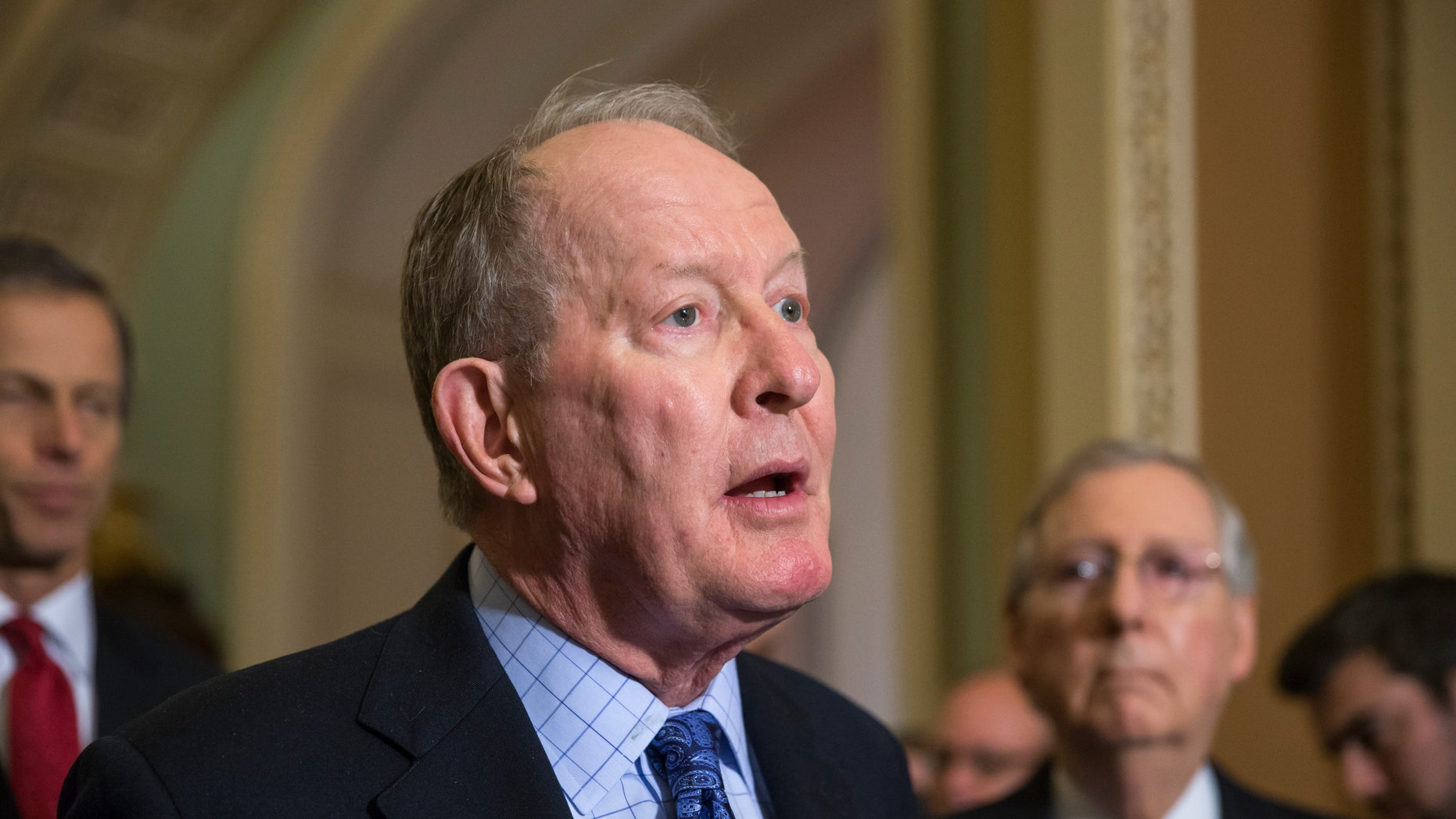 Dec. 8, 2015: Sen. Lamar Alexander, R-Tenn., chairman of the Senate Health, Education, Labor, and Pensions Committee, is joined by Senate Majority Leader Mitch McConnell, R-Ky., right, as he speaks to reporters after the Senate voted overwhelmingly to end debate on the makeover of the widely criticized No Child Left Behind Act, setting up a final vote.