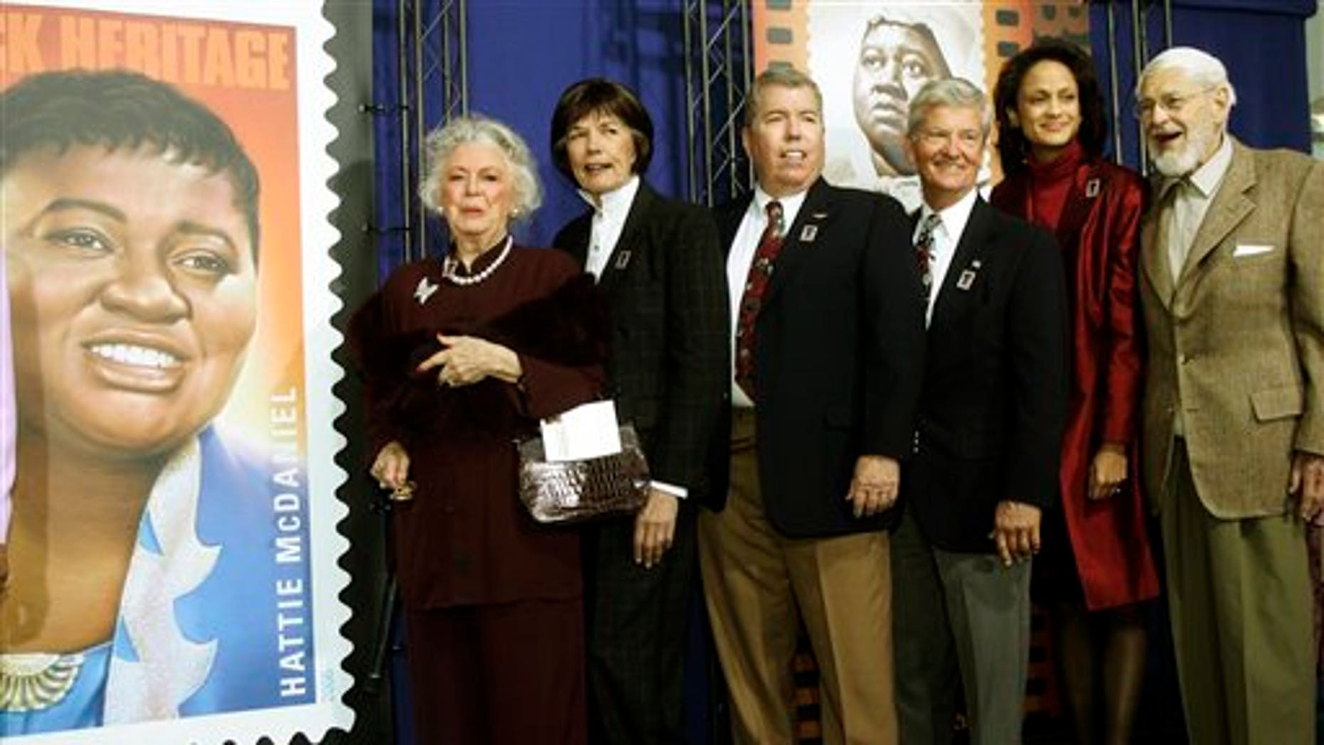 In this Jan. 25, 2006 photo, Ann-Marie Johnson, National First Vice President of the Screen Actors Guild second from right, joins Gone With the Wind cast, from left: Ann Rutherford, Cammie King Conlon, Mickey Kuhn, Patrick Curtis and Fred Crane to celebrate actress Hattie McDaniel's stamp. (AP)