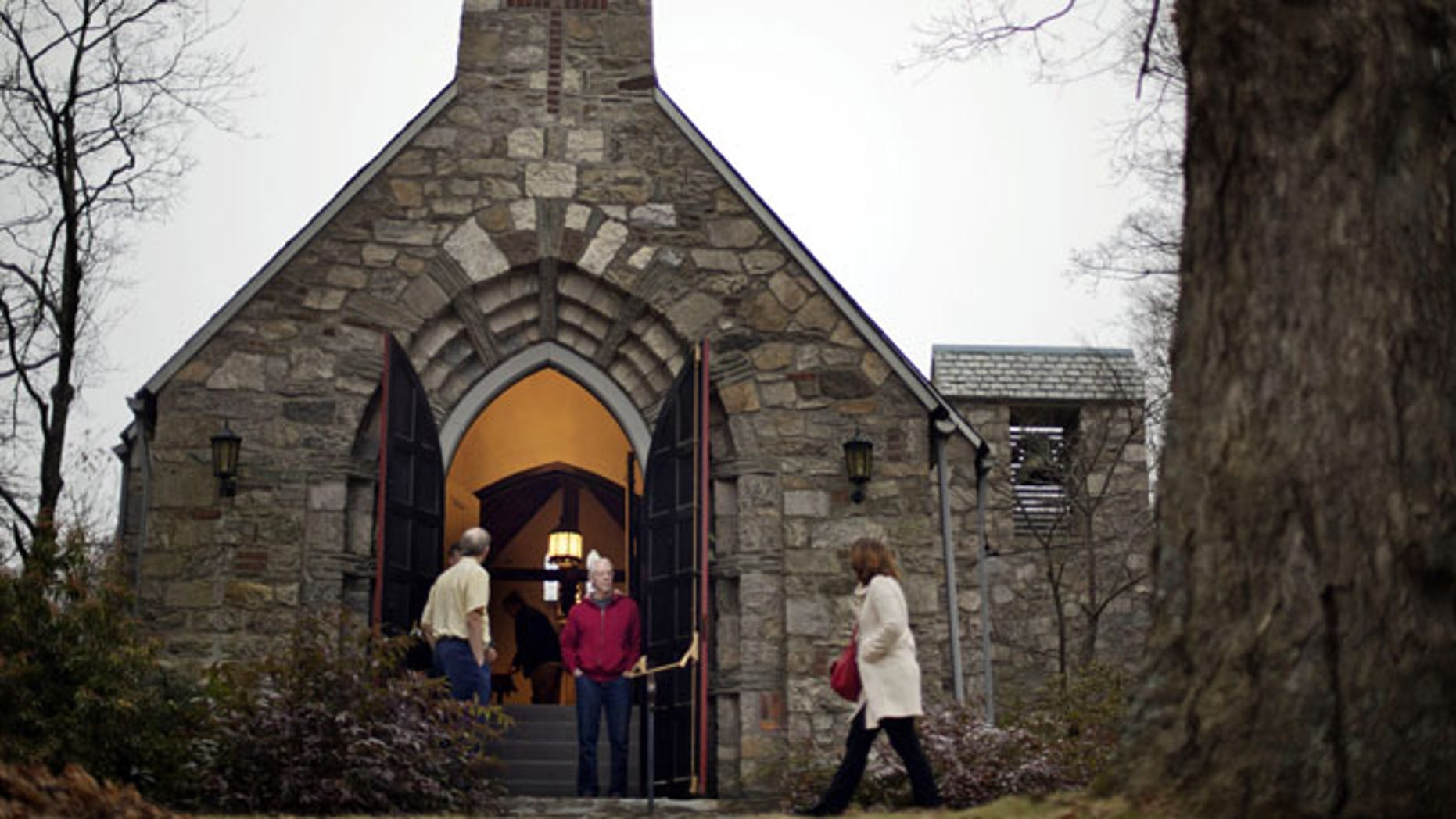 Dec. 16, 2012: A churchgoer enters a service at at St John's Episcopal Church, in Newtown, Conn.