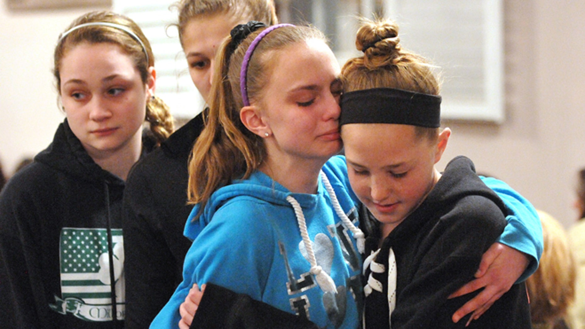 April 25, 2014:  Friends and family including many students from Jonathan Law High School attend a memorial service at the First United Church of Christ in Milford, Conn., for Maren Sanchez who was killed at the school.