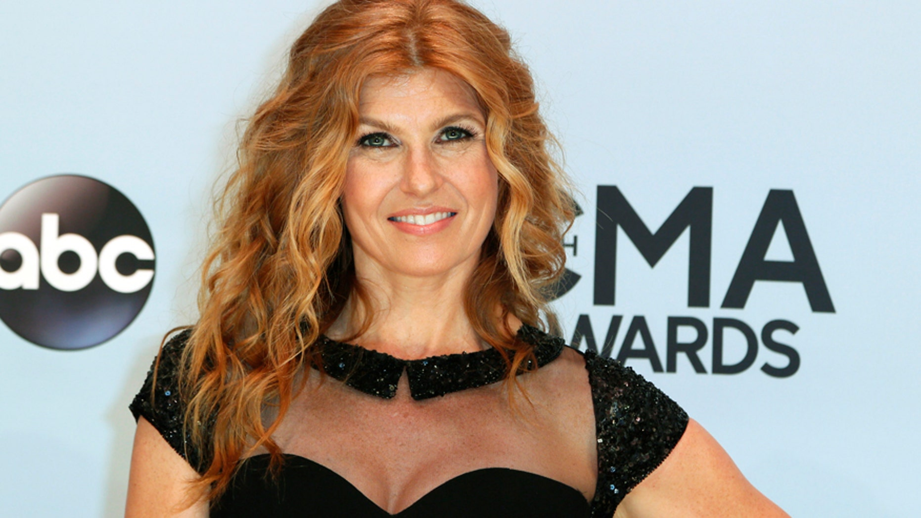 Connie Britton poses on arrival at the 47th Country Music Association Awards in Nashville, Tennessee November 6, 2013.