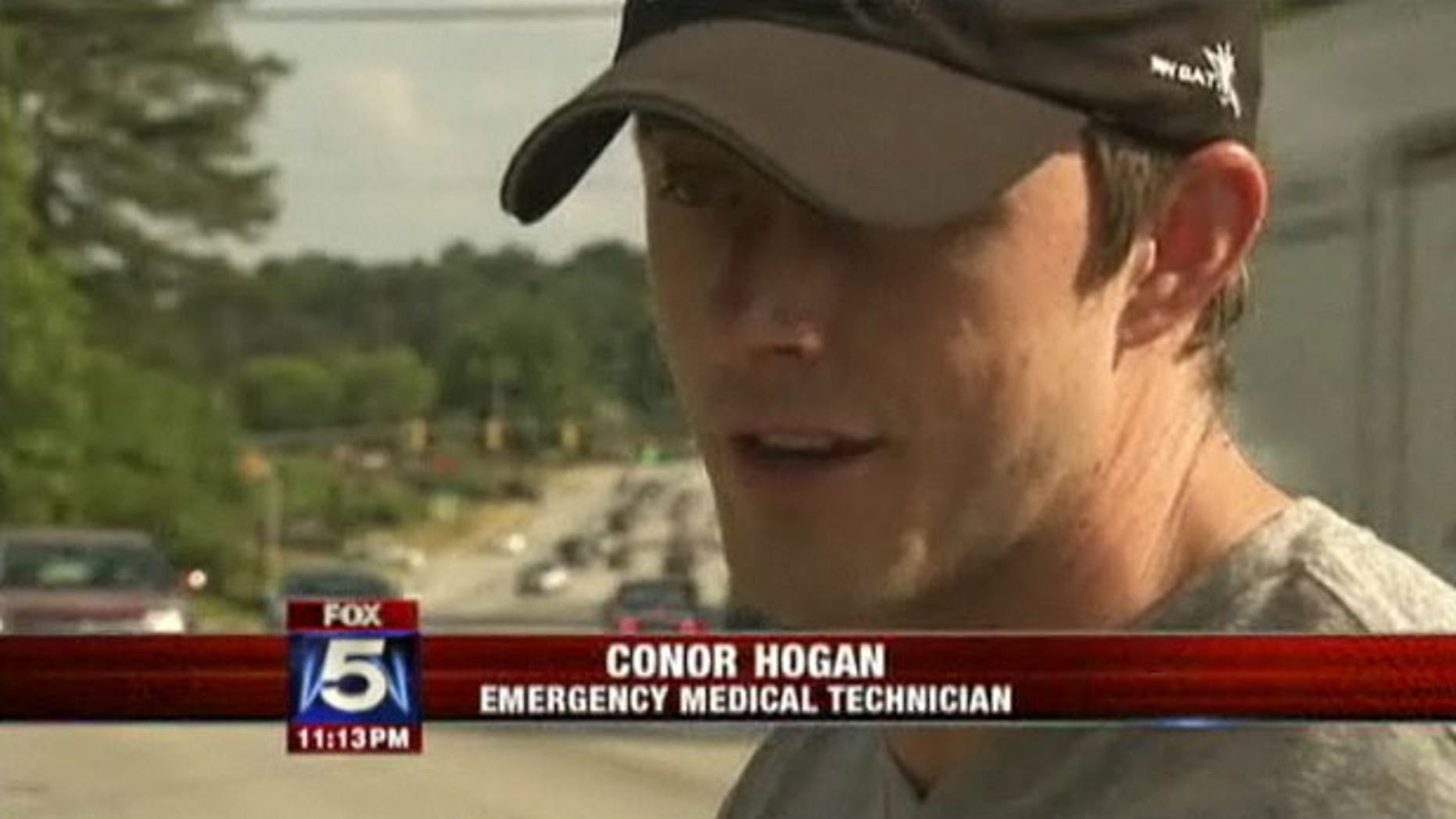 Conor Hogan helped save a runner's life after the woman collapsed on the sidewalk.