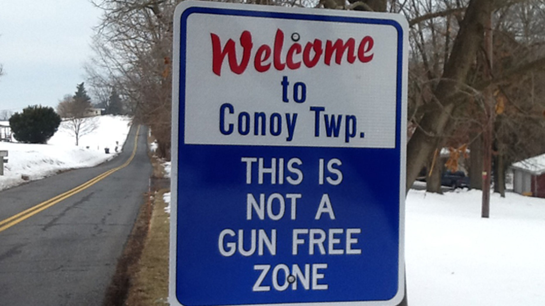 Signs marking the entry into the central Pennsylvania town of Conoy warn that the population may be armed. (Courtesy: Stephen Mohr)