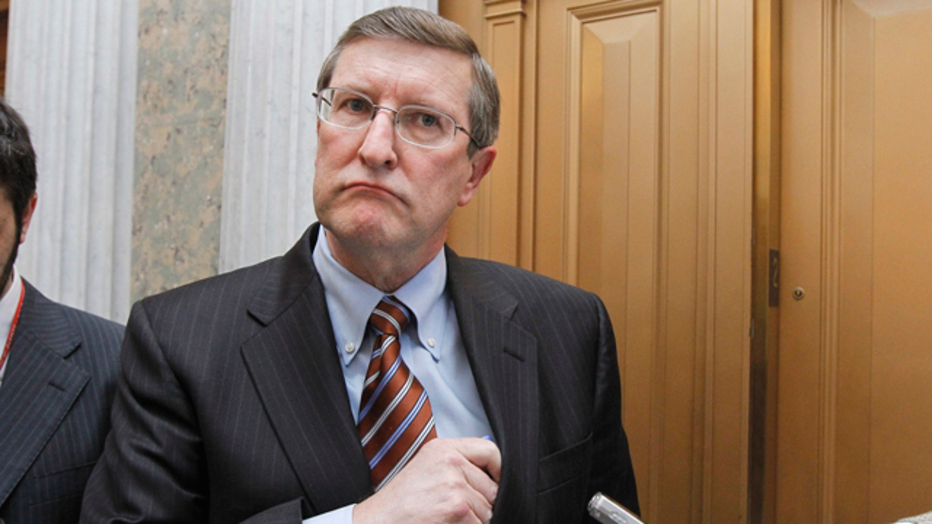 Senate Budget Committee Chairman Sen. Kent Conrad, D-N.D., talks to reporters on Capitol Hill