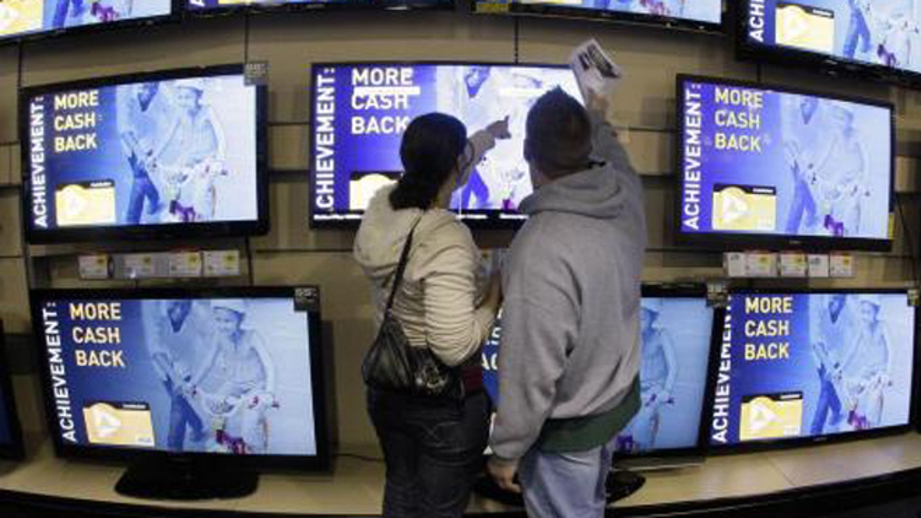 Consumers shop for TVs at a Best Buy store in Brentwood, Tenn. But will they buy in the store -- or online, where they may find a bargain?