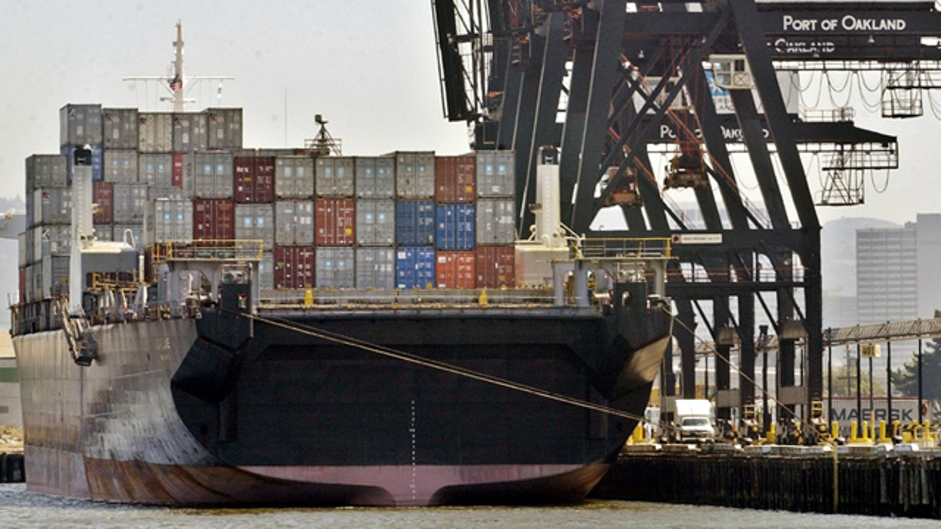FILE: A container ship docked at Port of Oakland.