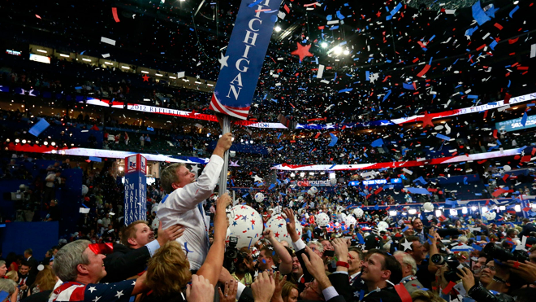 In this Aug. 30, 2012, file photo, Michigan delegates celebrate after Mitt Romney accepts the nomination at the Republican National Convention in Tampa, Florida. (REUTERS)