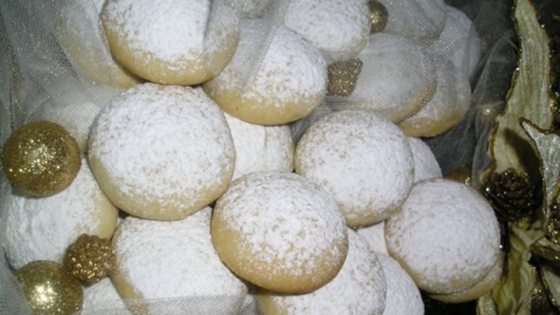 A Bulgarian baker was arrested after serving cocaine-sprinkled cookies to guests at a Greek funeral, news website Novinite reported Wednesday.