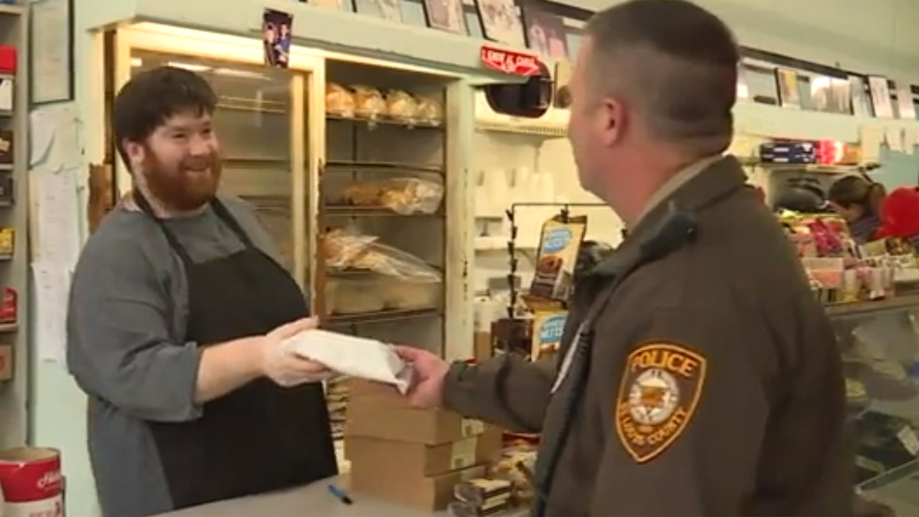 """A """"mystery man"""" is paying for local police officers at a deli in suburban St. Louis."""