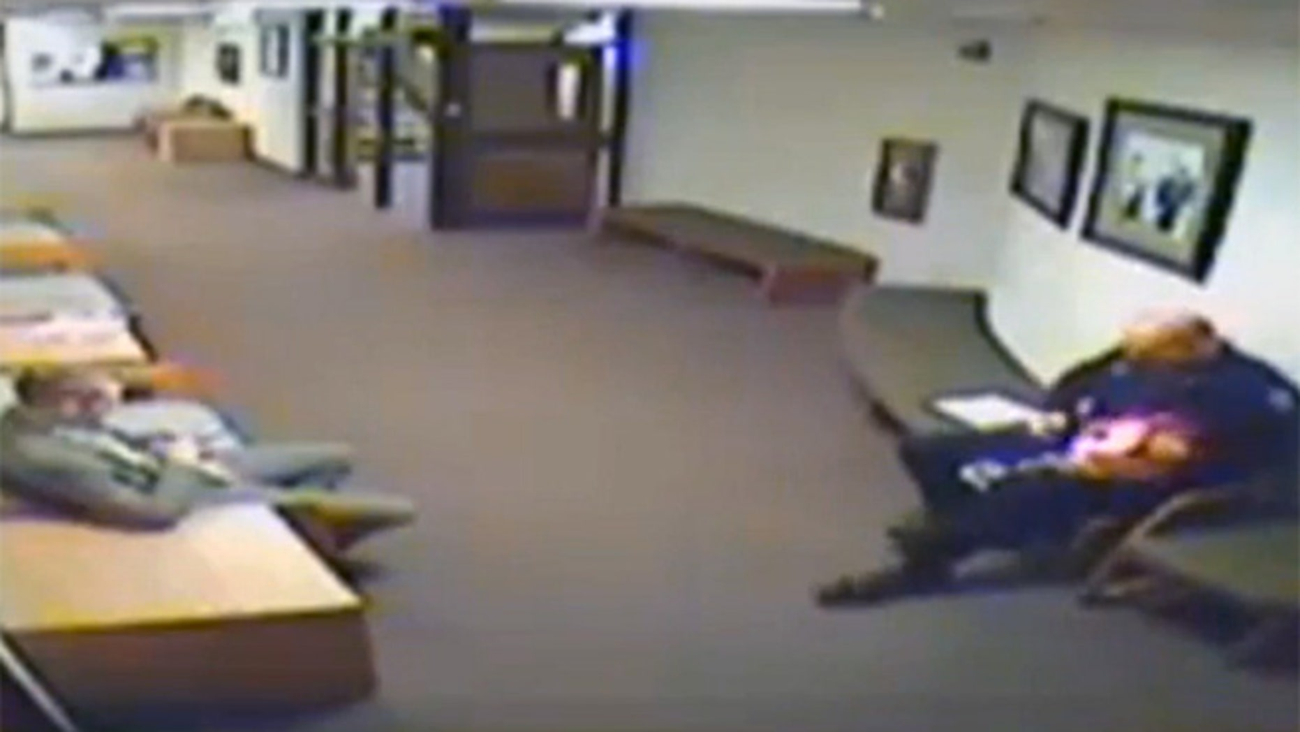 Surveillance video shows the little girl taking the 6 foot, 6 inch tall officer by his finger and walking around the courthouse with him, gathering treats from other deputies.