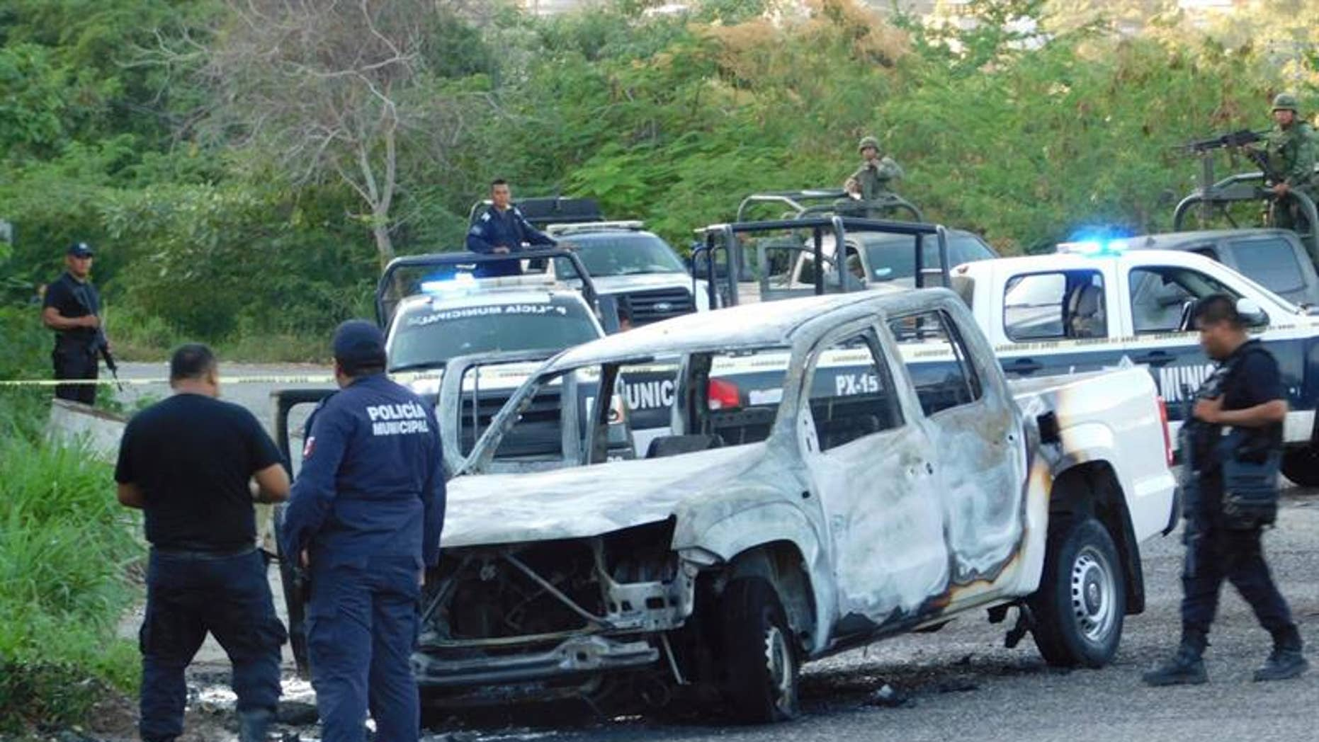 This is the vehicle where three members of Mexico's federal police were found burned to death on Dec. 8, 2016.