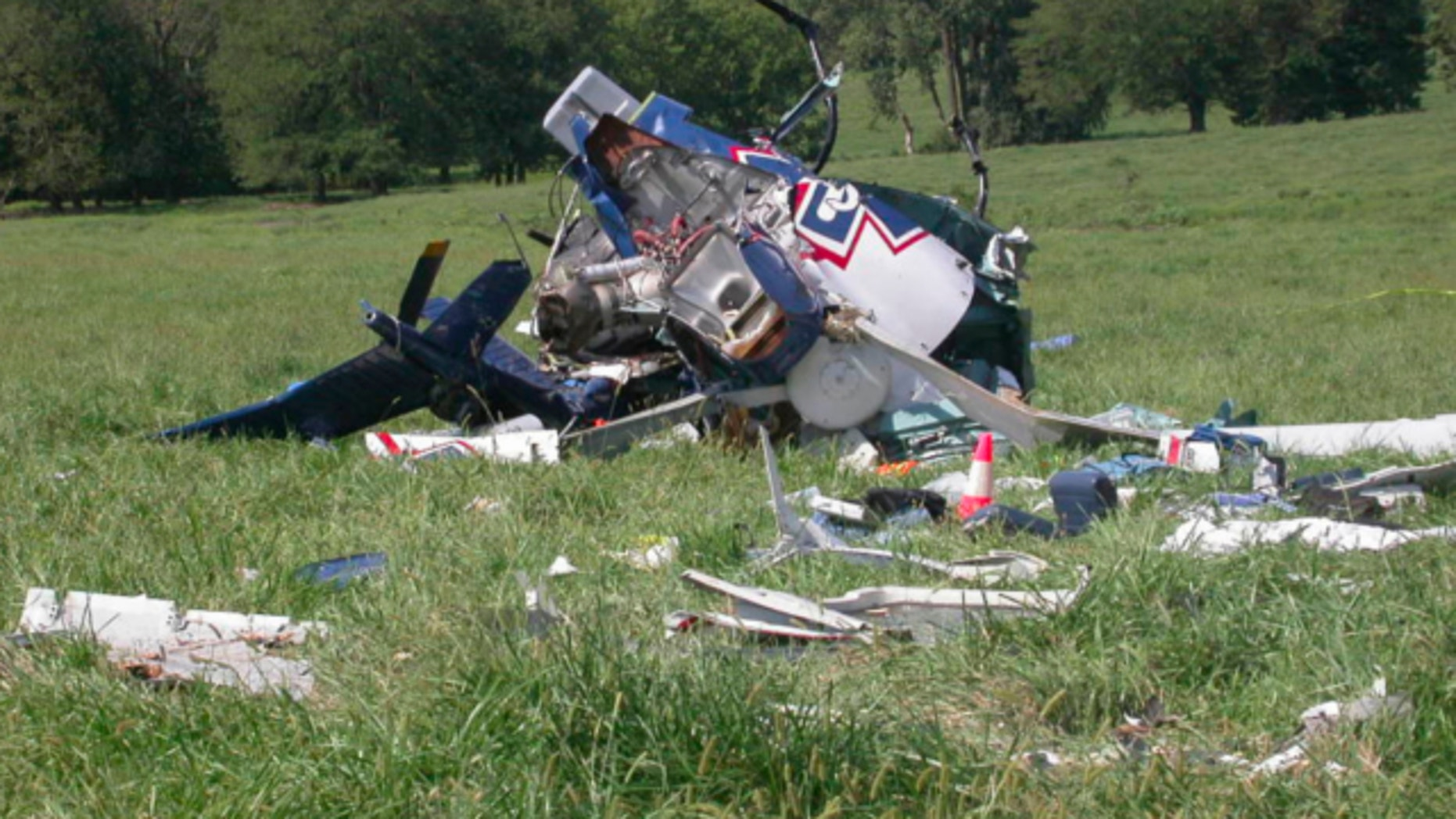Aug. 26, 2011: This photo provided by the National Transportation Safety Board, shows the wreckage of a helicopter that crashed near Mosby, Mo.