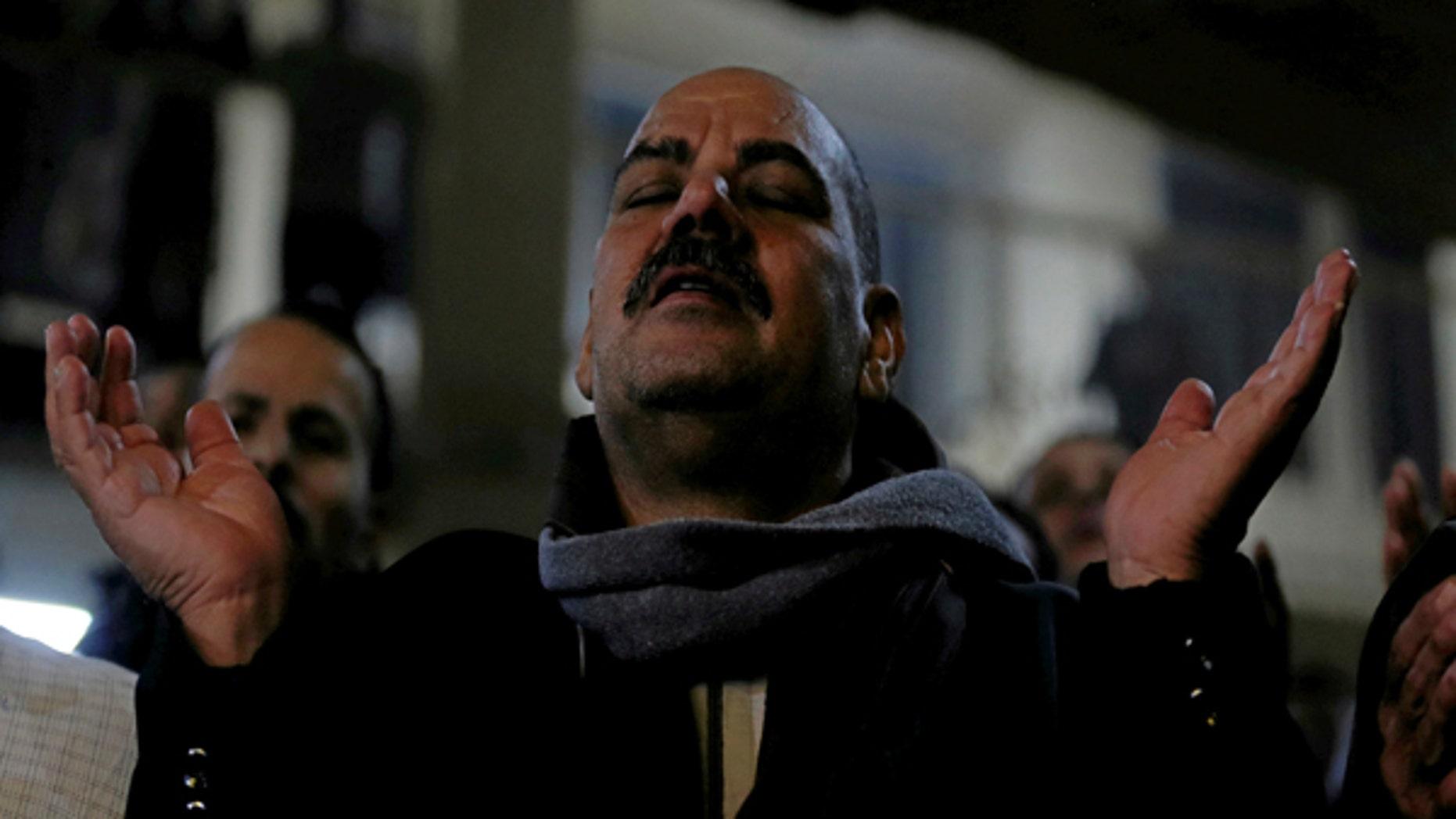 January 6, 2017: An Egyptian Christian attends Egypt's Coptic Christmas eve mass in a church of the Samaan el-Kharaz Monastery in the Mokattam Mountain area of Cairo, Egypt.