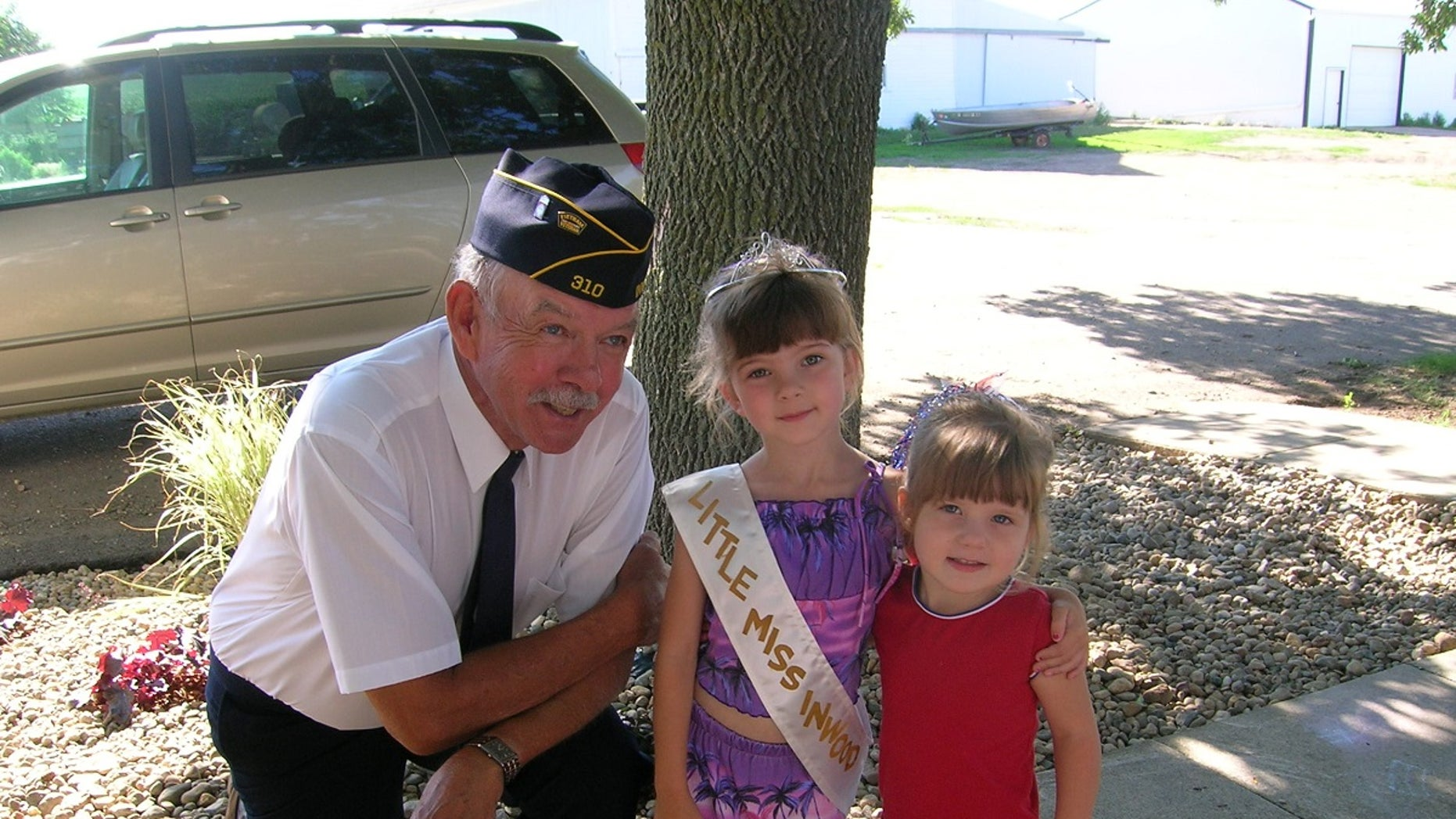 Paul and his granddaughters on the day of a Fourth of July parade.