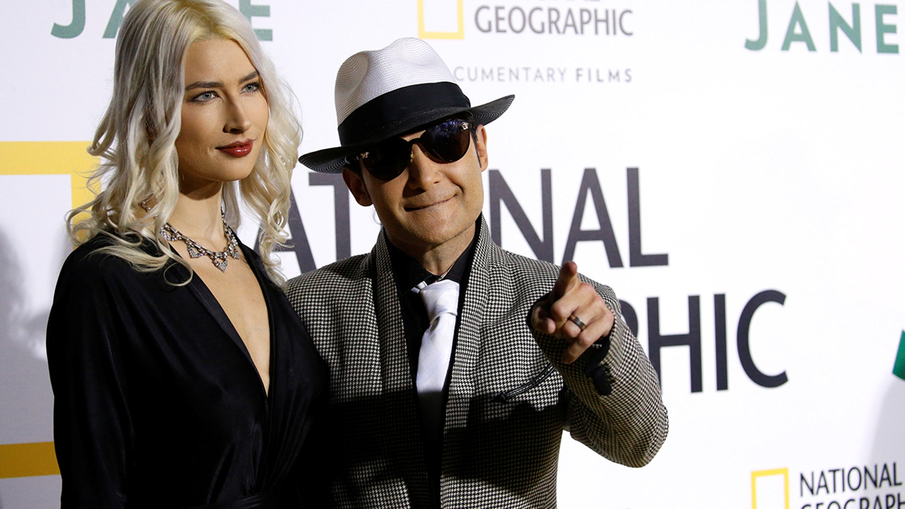 """Actor Corey Feldman and his wife Courtney Anne Mitchell pose at the premiere for the documentary """"Jane"""" in Los Angeles, California, U.S., October 9, 2017."""