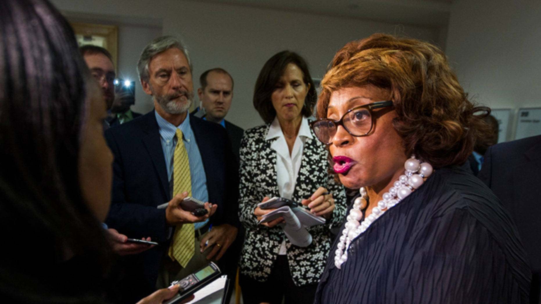 In this Aug. 13, 2015 file photo, Rep. Corrine Brown, D-Fla. talks with the press in Tallahassee, Fla.